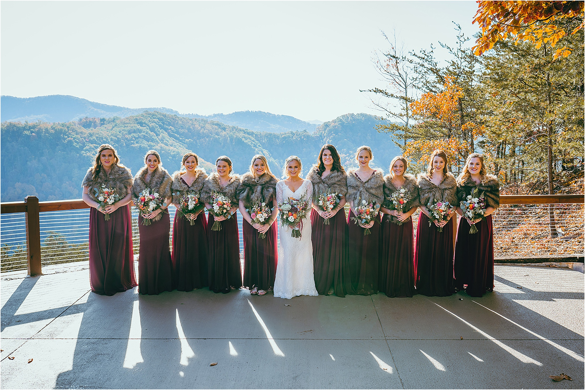 bridal party in burgundy and navy colors