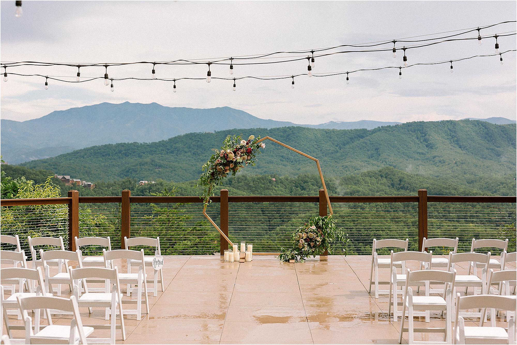 geometric wedding arbor with pink flowers