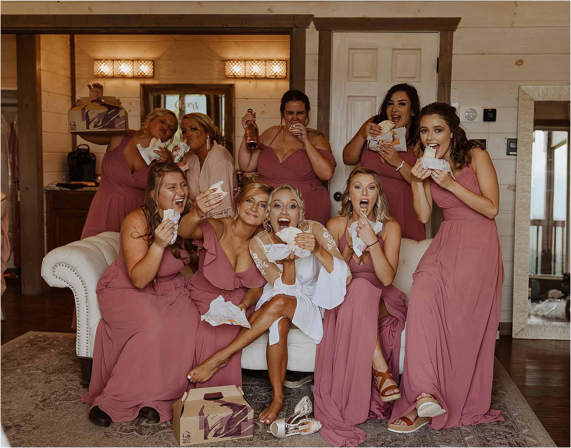 bride and bridesmaids eating Taco Bell
