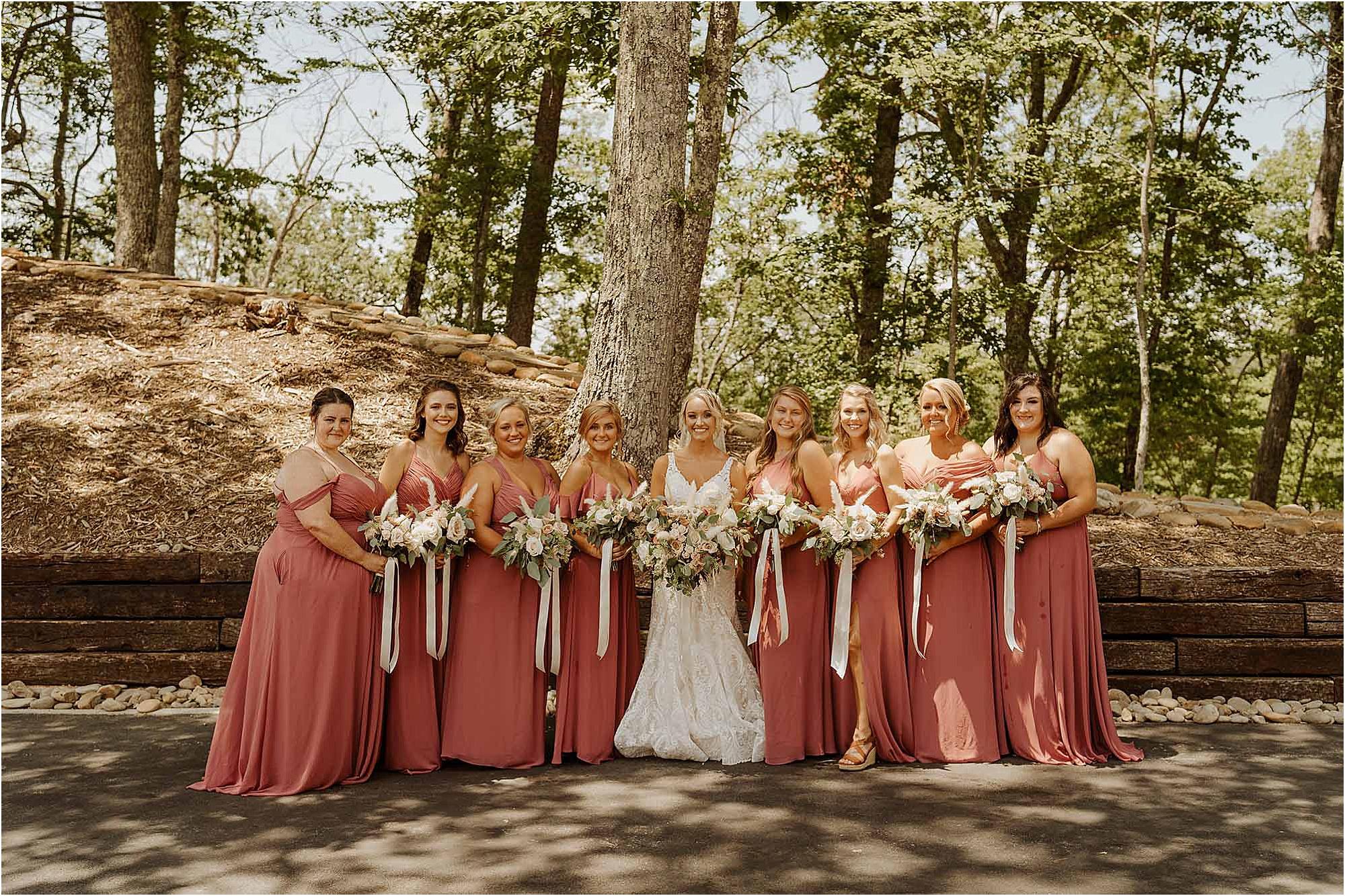 bride and bridesmaids in blush bridesmaids dresses
