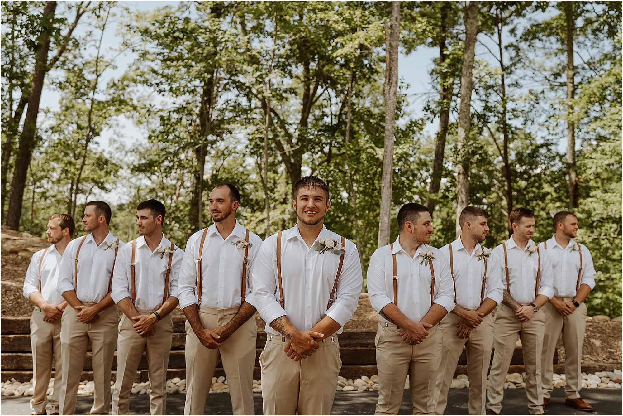 groom and groomsmen photo in woods