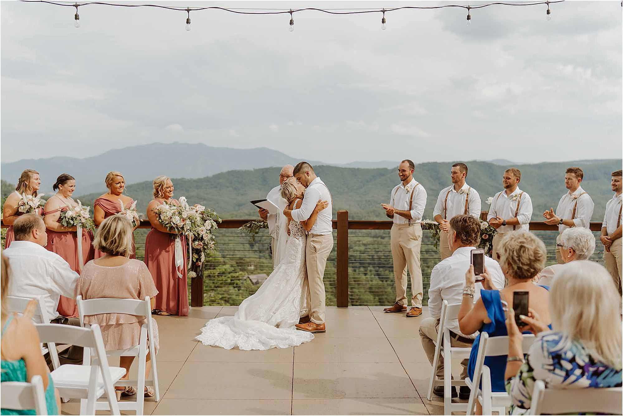 bride and groom kiss at summer wedding in Pigeon Forge