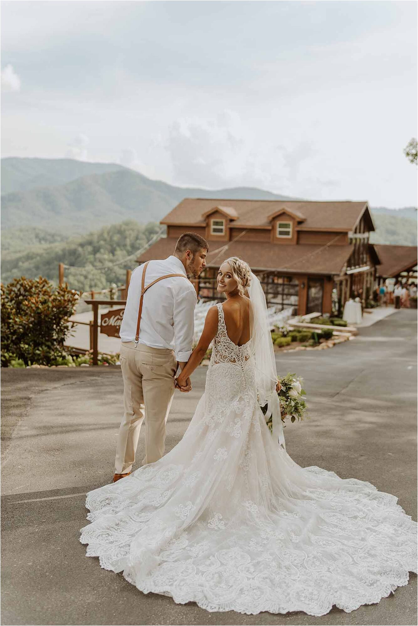 bride and groom standing in front of mountain wedding venue