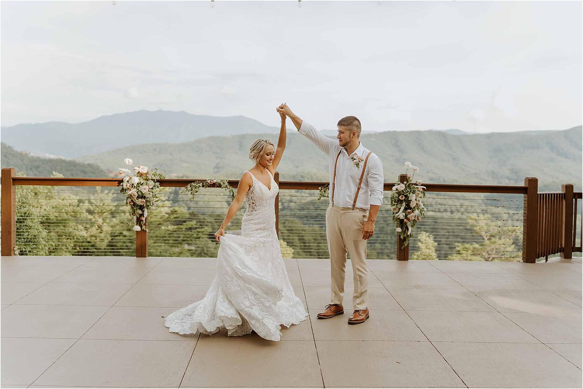 groom twirling bride on patio