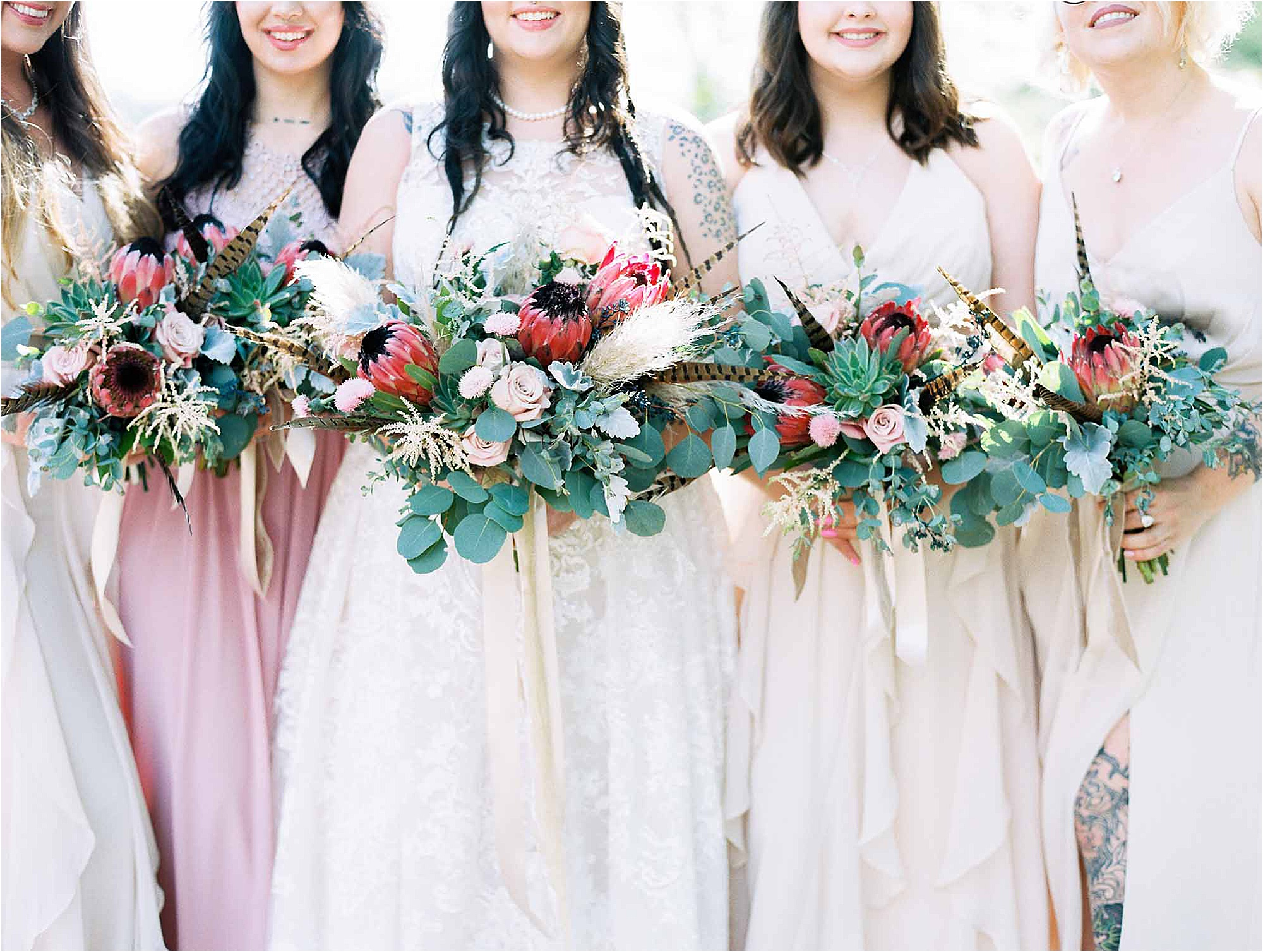 bride and bridesmaids holding pink and green wedding bouquets