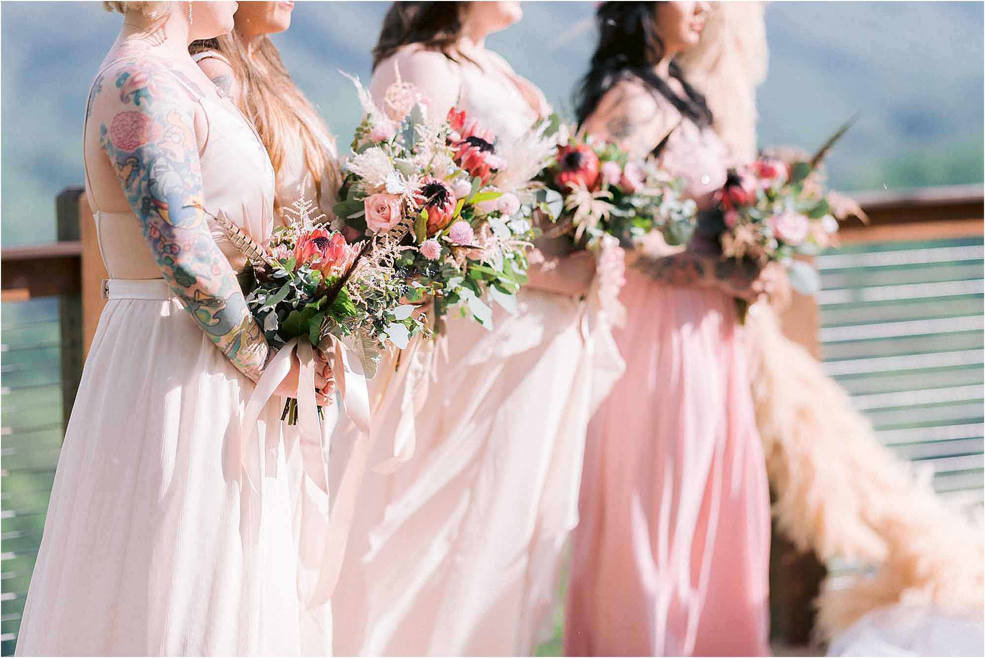 pink bridesmaid dresses with green bridal bouquets