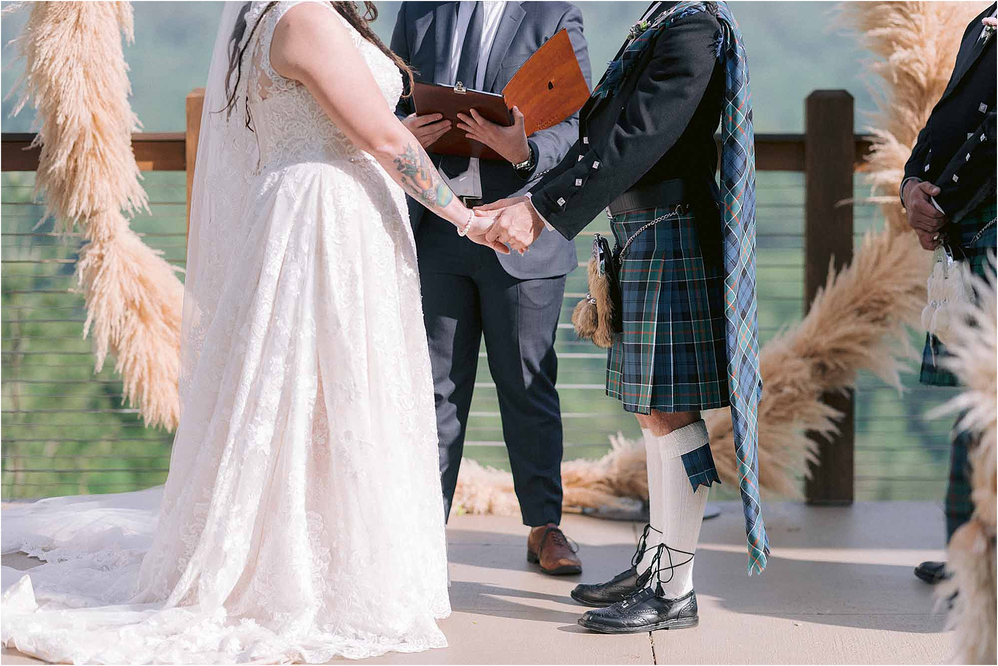 bride and groom with kilt holding hands at ceremony