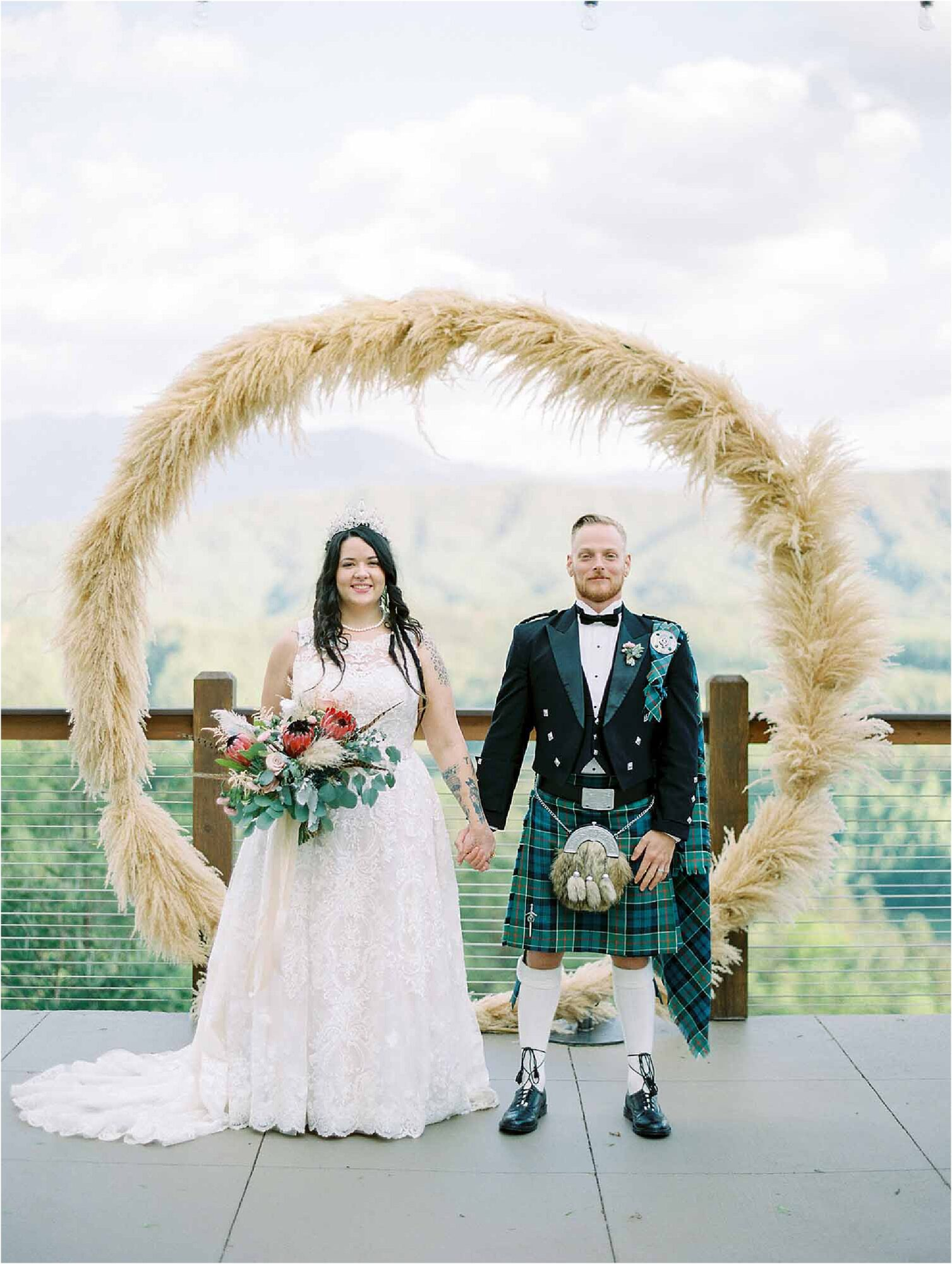 bride and groom stand in front of circle wedding arbor
