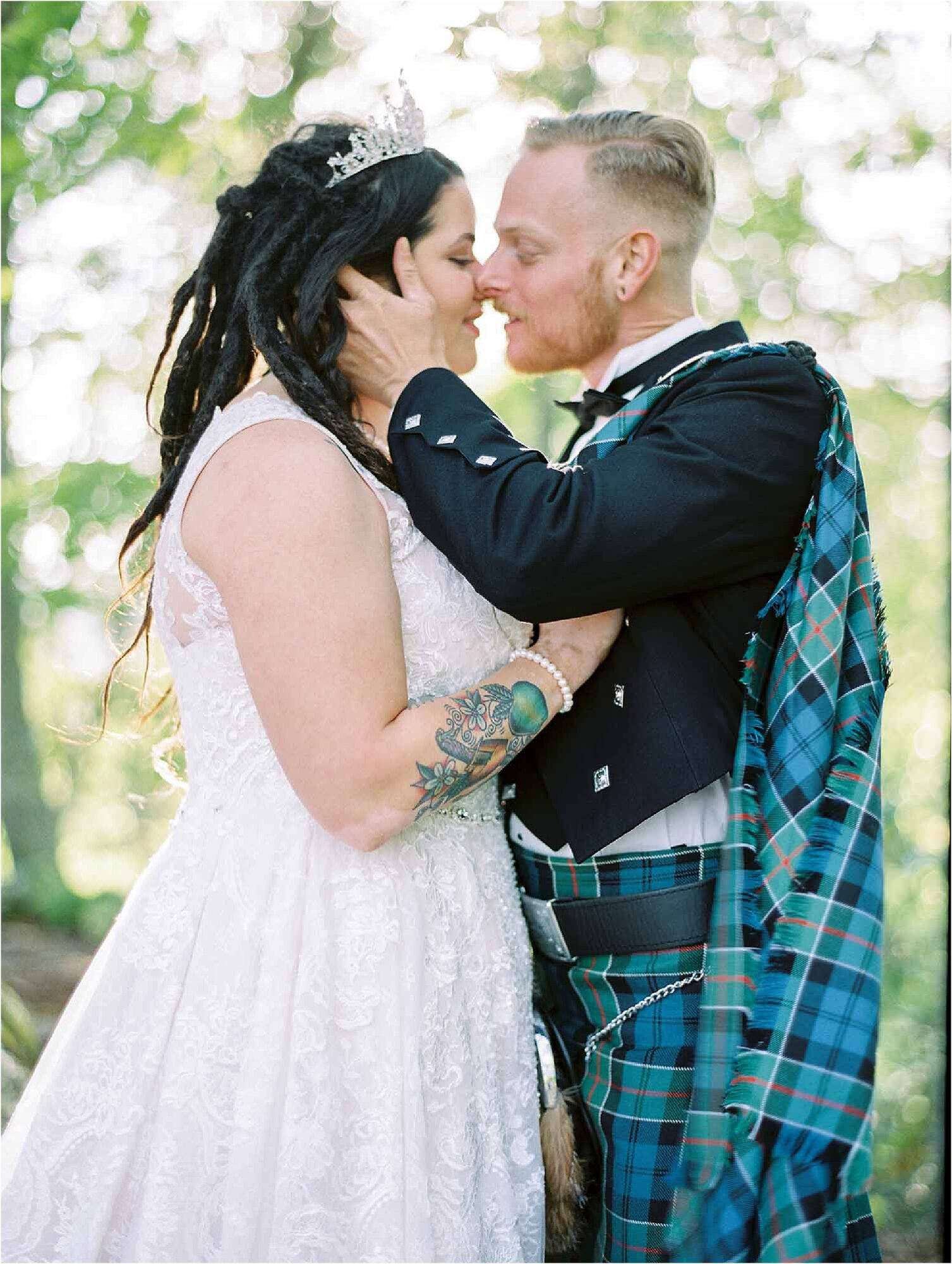 bride and groom in kilt kiss