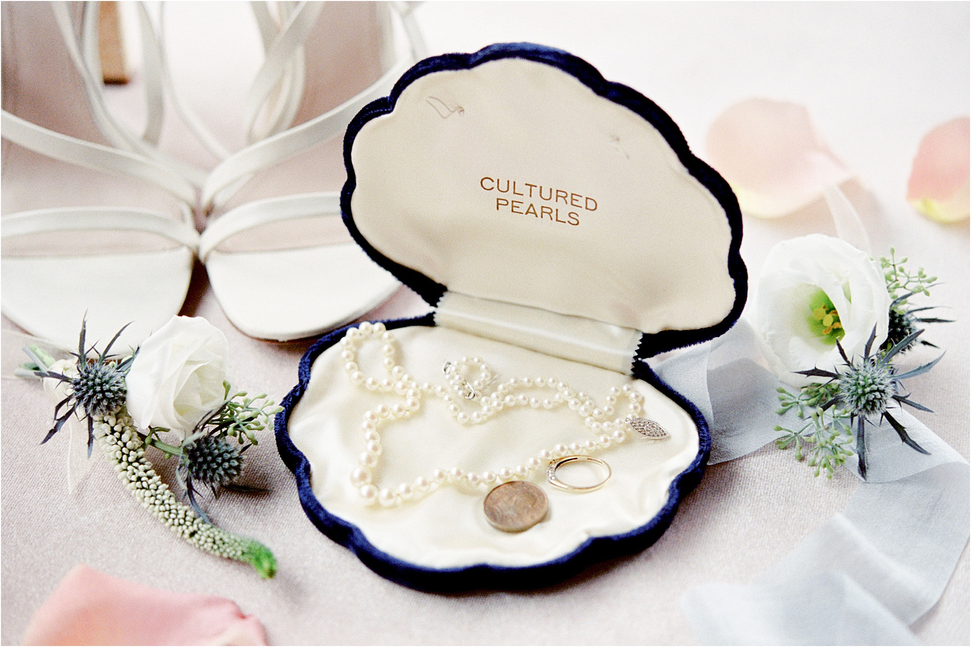 pearl necklace in a blue shell box