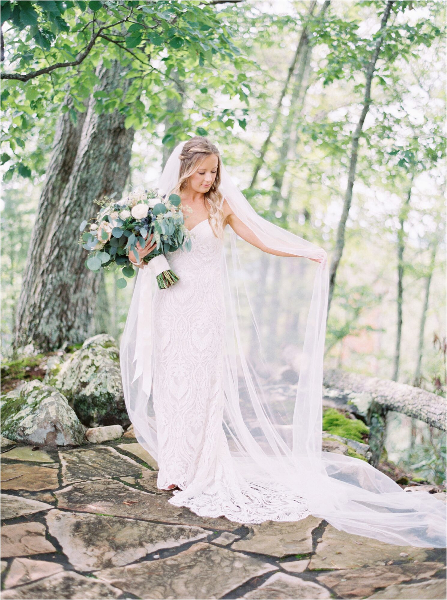bride holding veil and bouquet