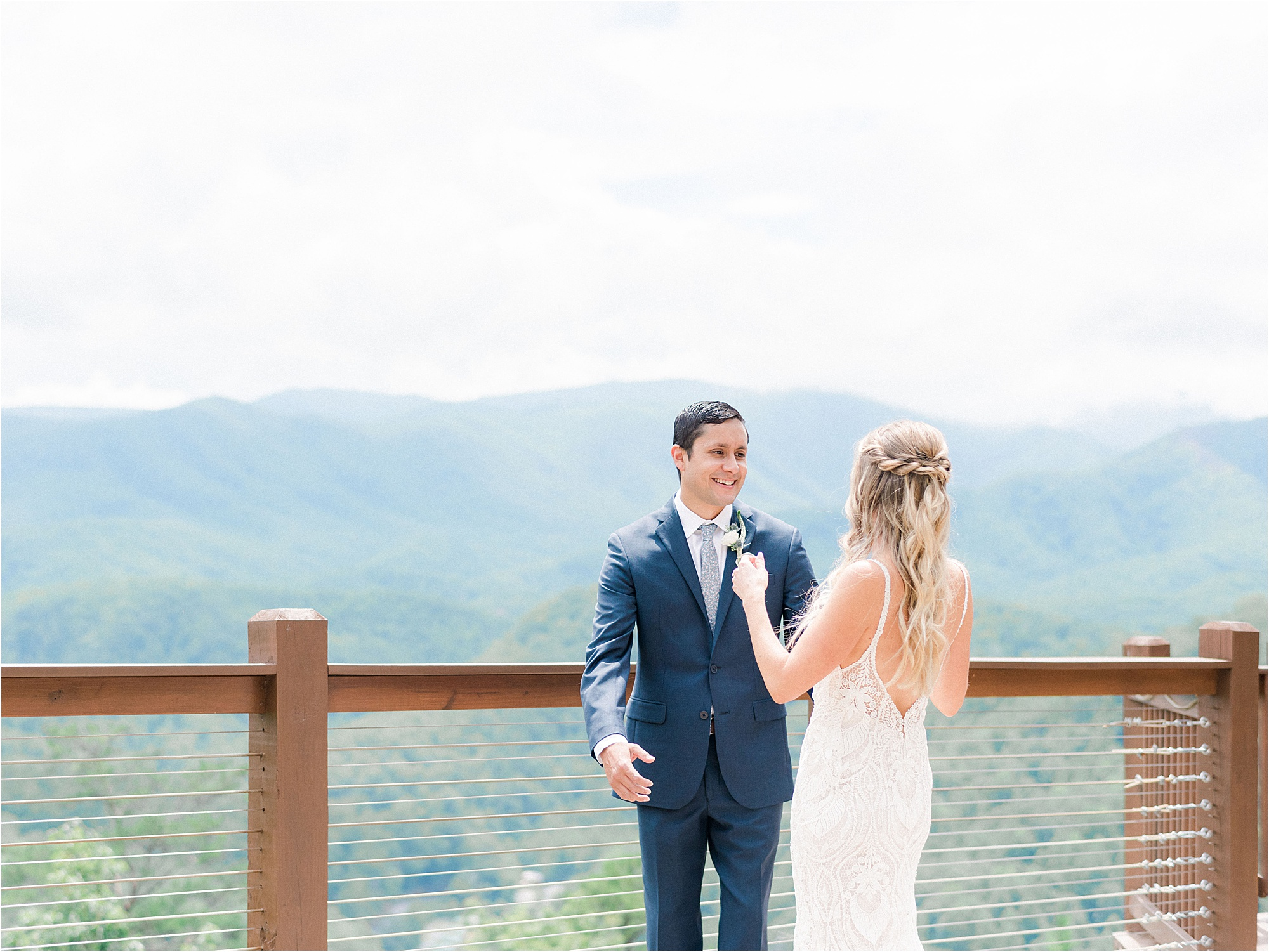 bride and groom first look overlooking mountains