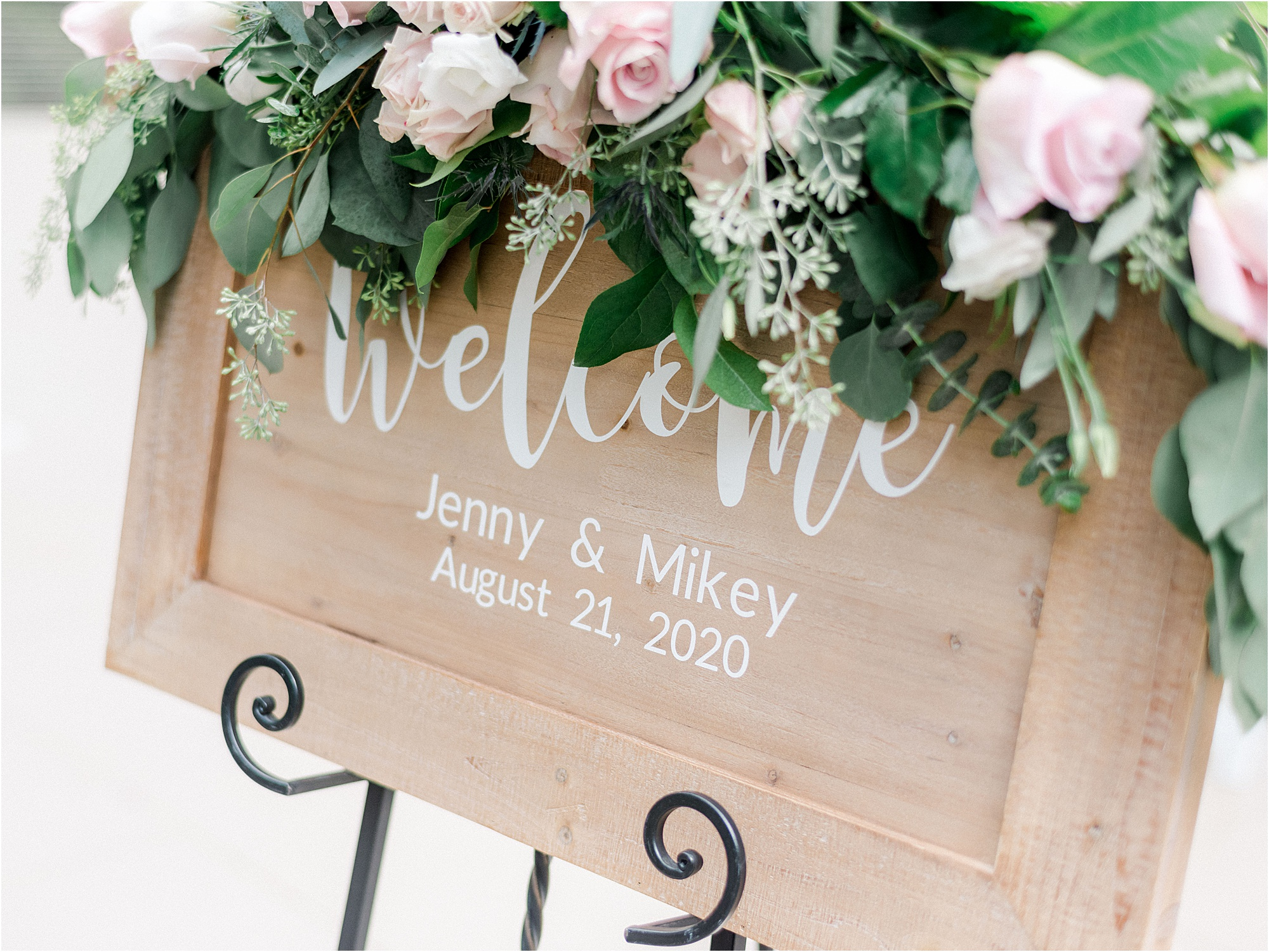 wedding sign with pink flowers