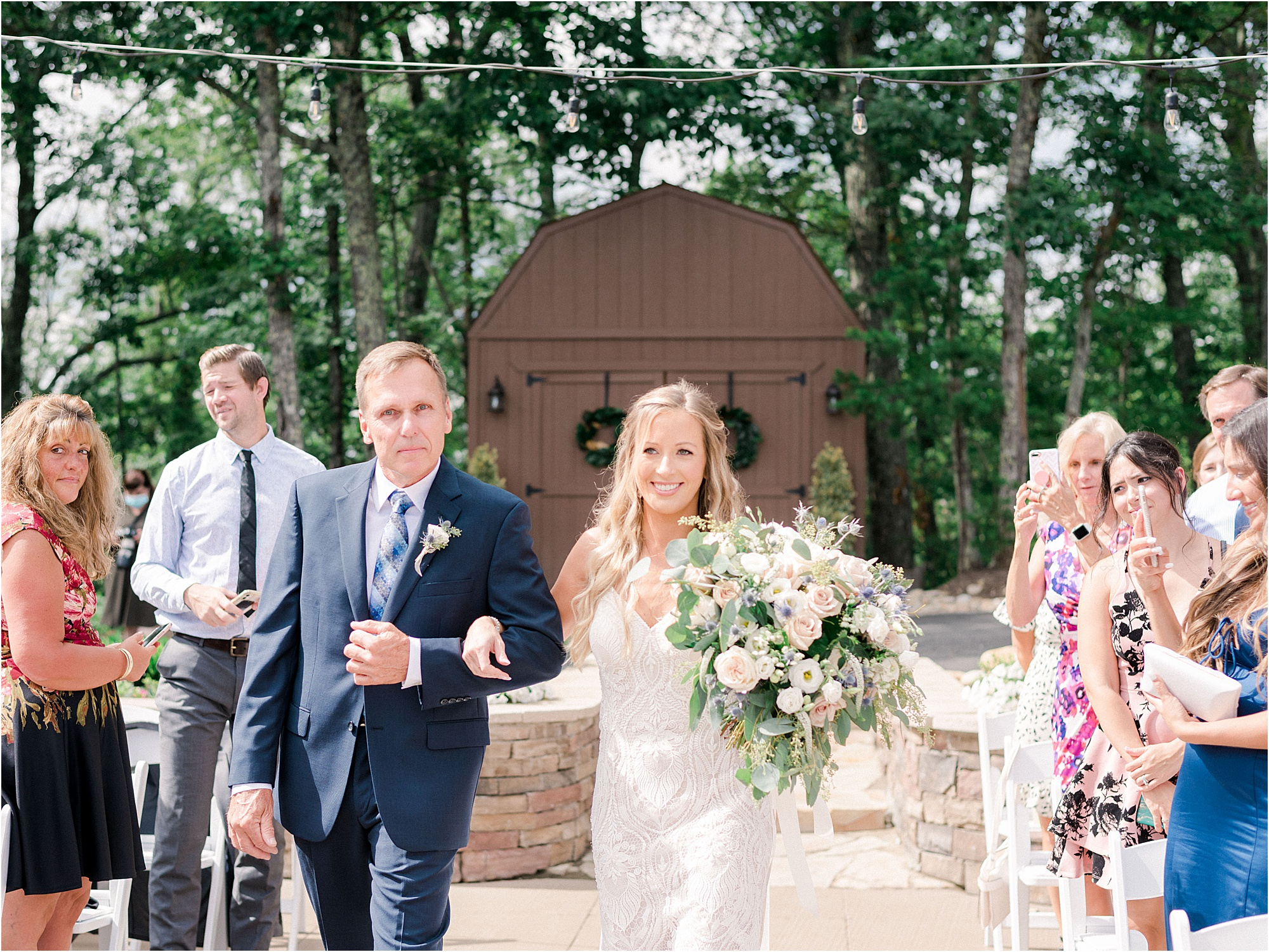 bride walking with father down the aisle at wedding