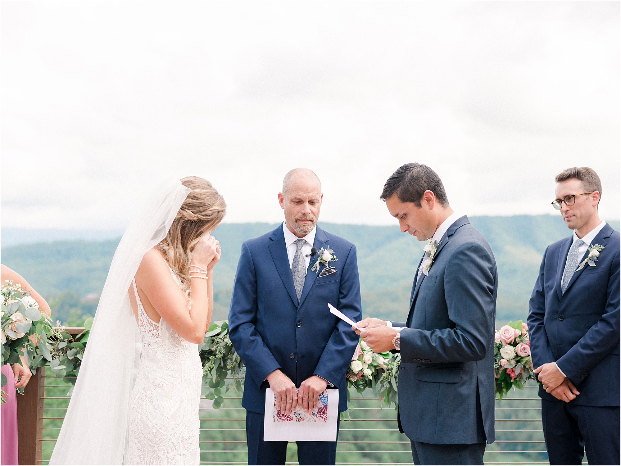 groom reading bride wedding vows and bride is crying