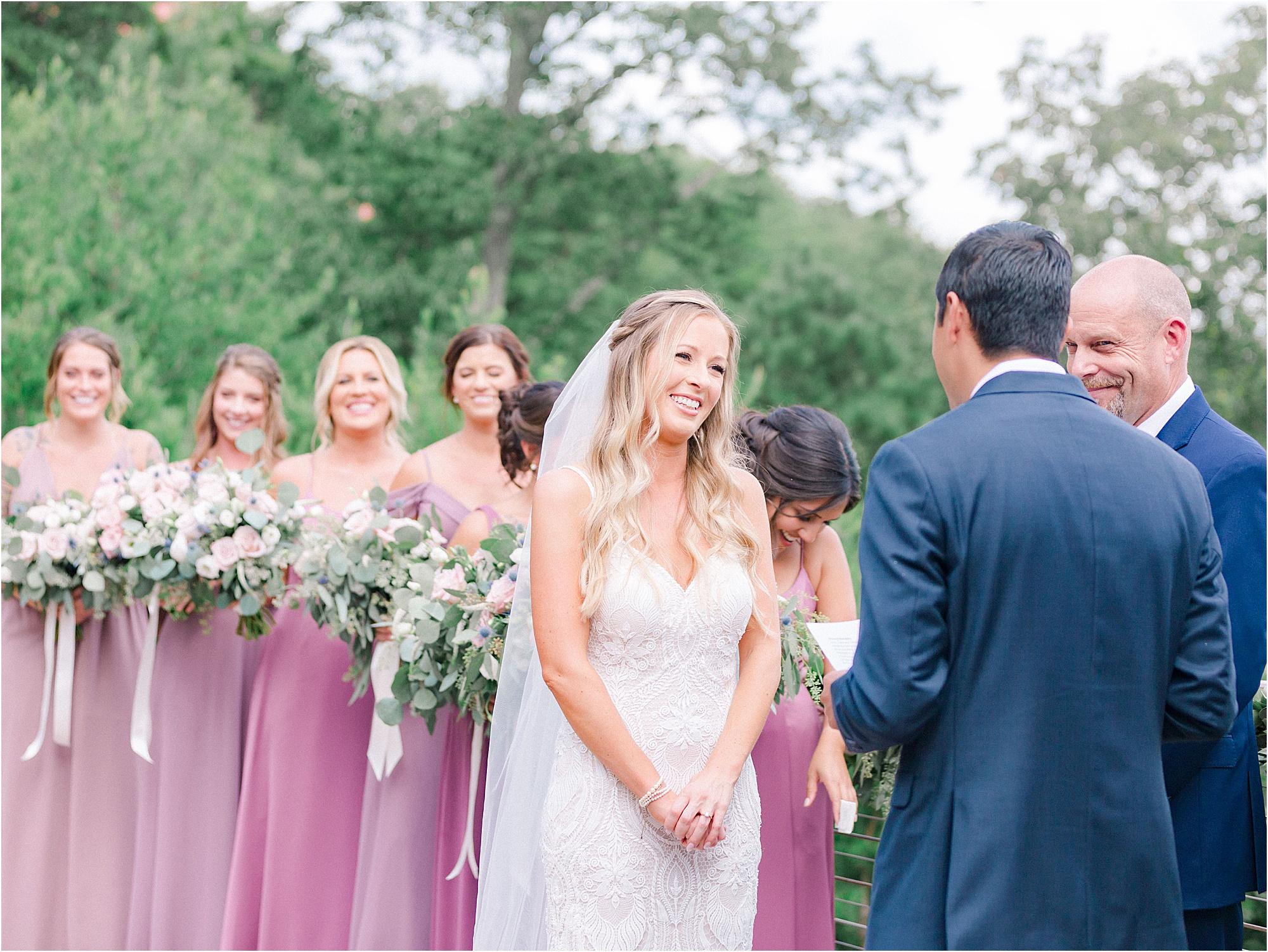 bride watching groom read wedding vows