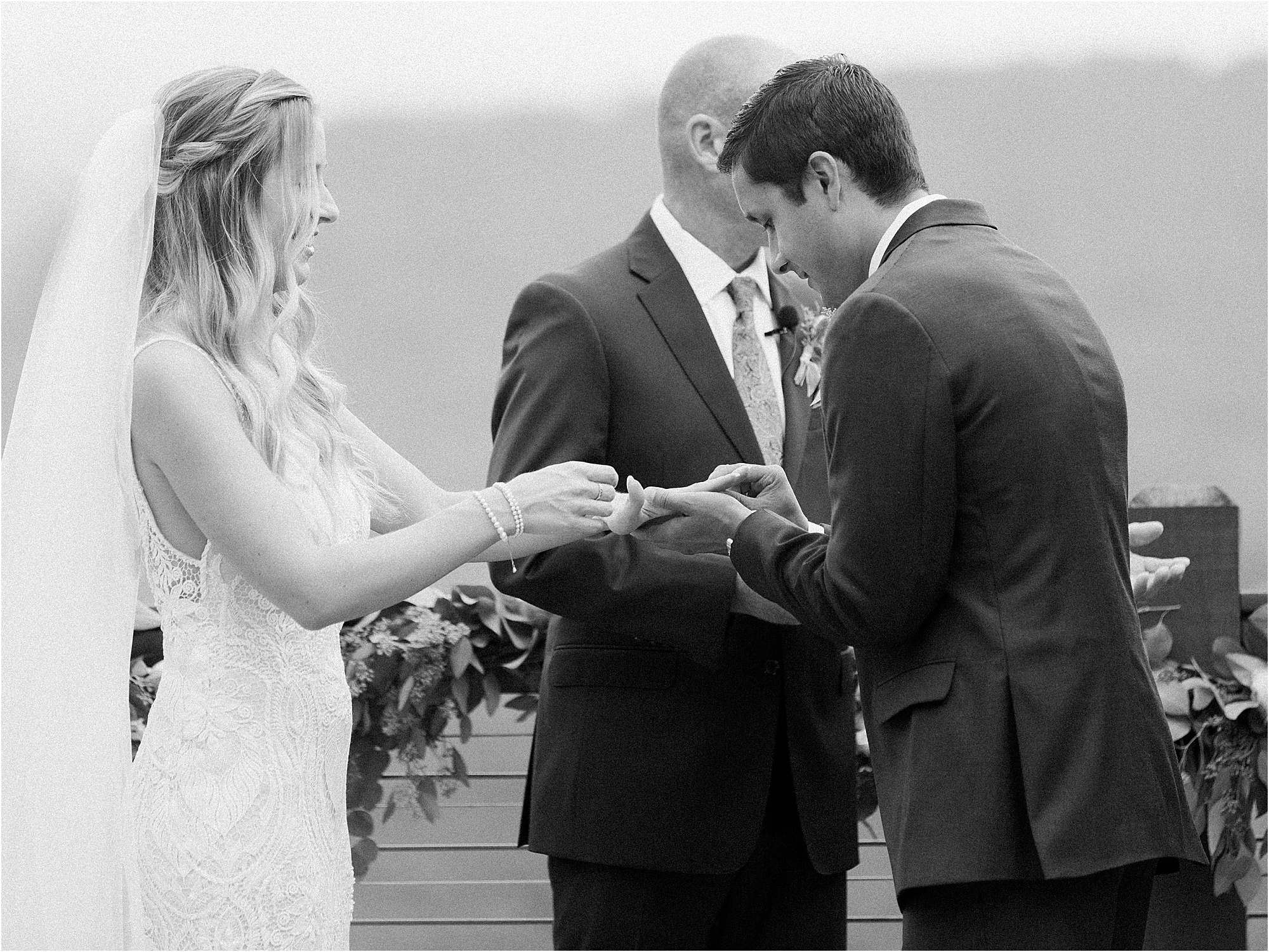 groom and bride exchange wedding rings