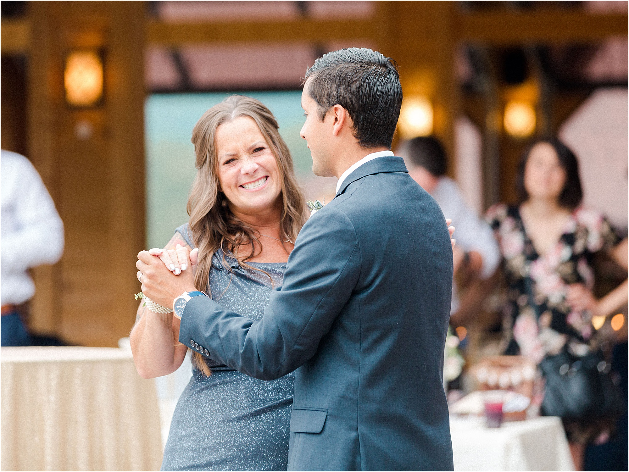 groom and mother dance at wedding reception