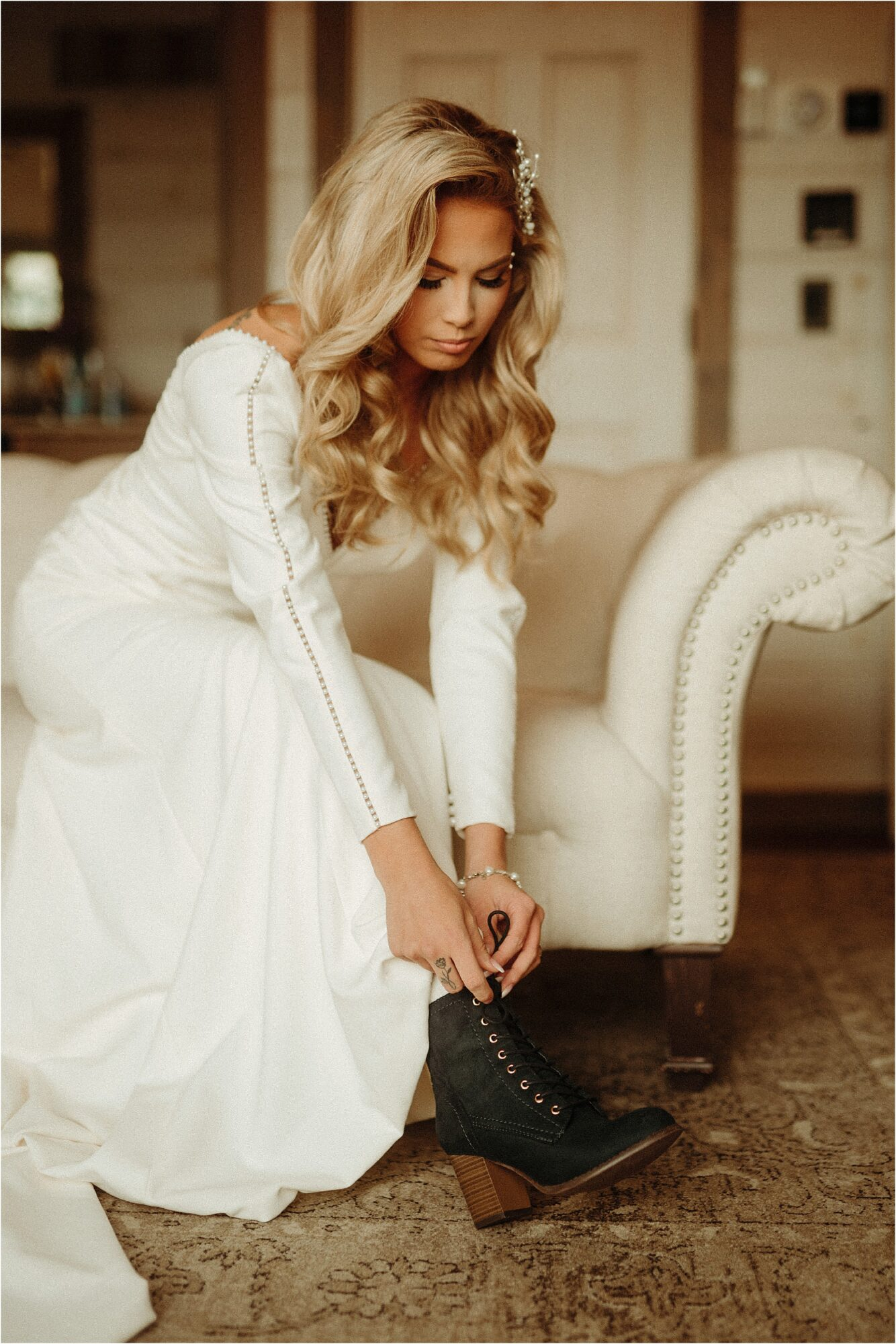bride in edgy dress putting on black wedding boots