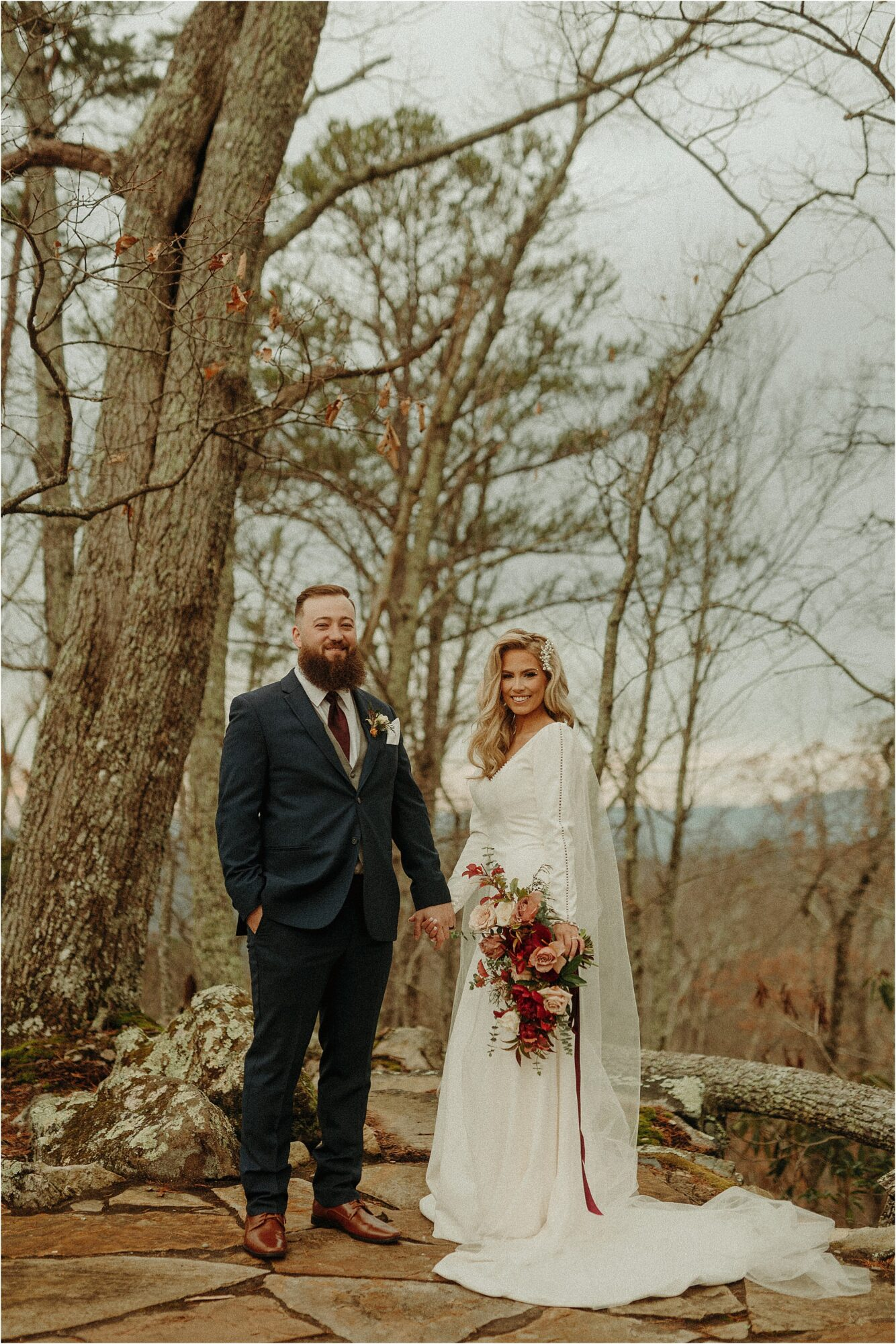 bride and groom holding hands in woods at The Magnolia Venue