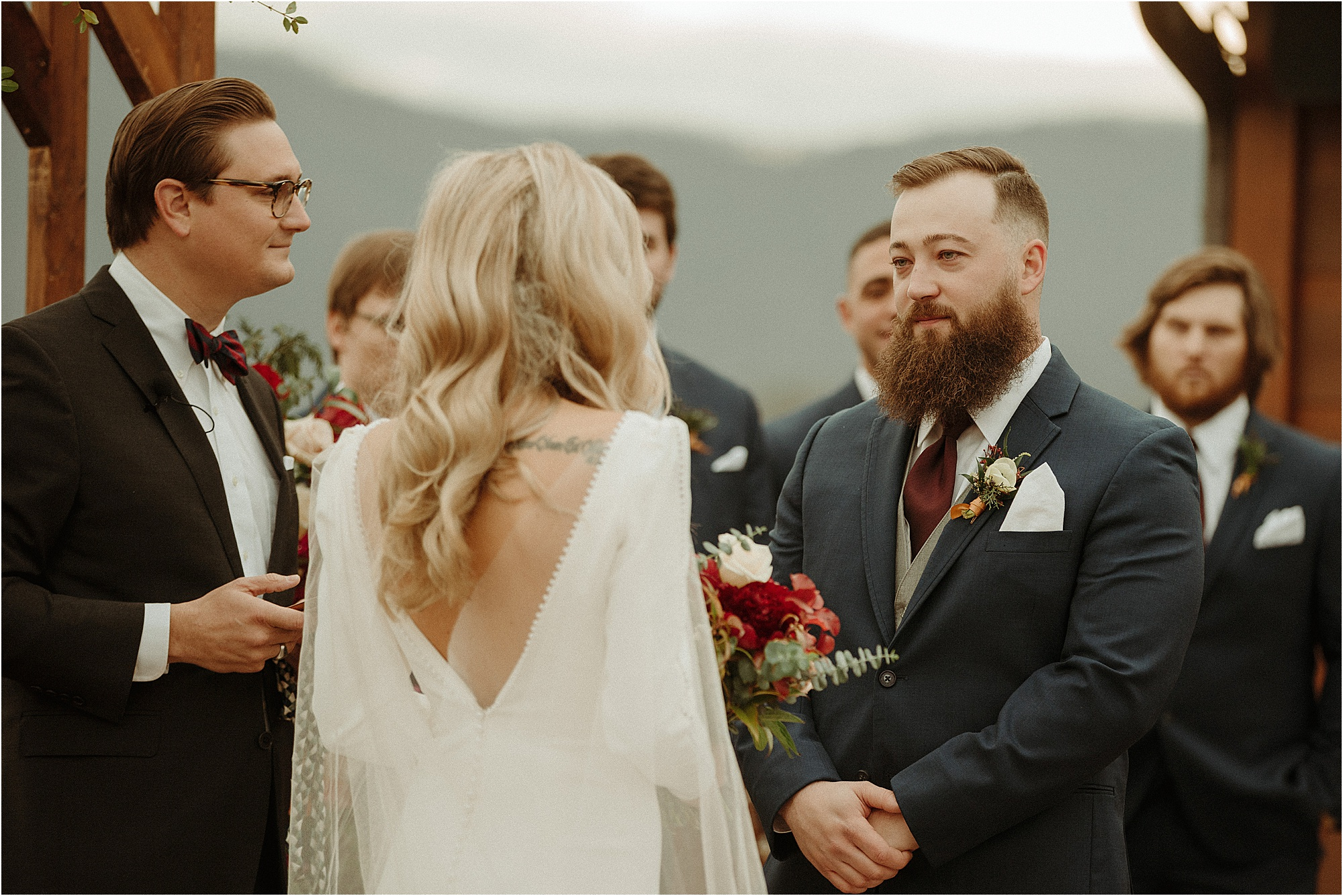 bride reads vows to groom at wedding ceremony