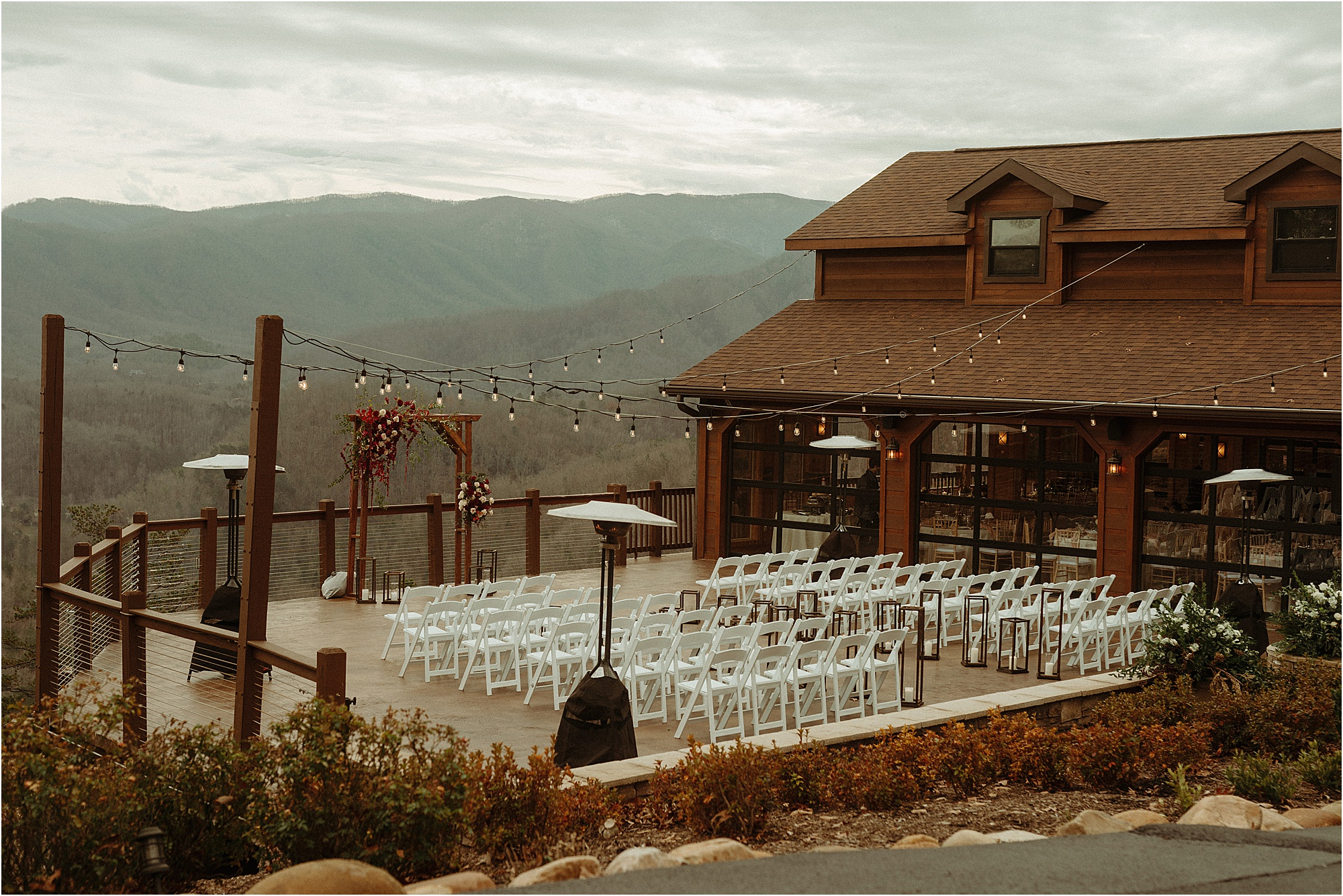 mountainside wedding ceremony with arbor and chairs