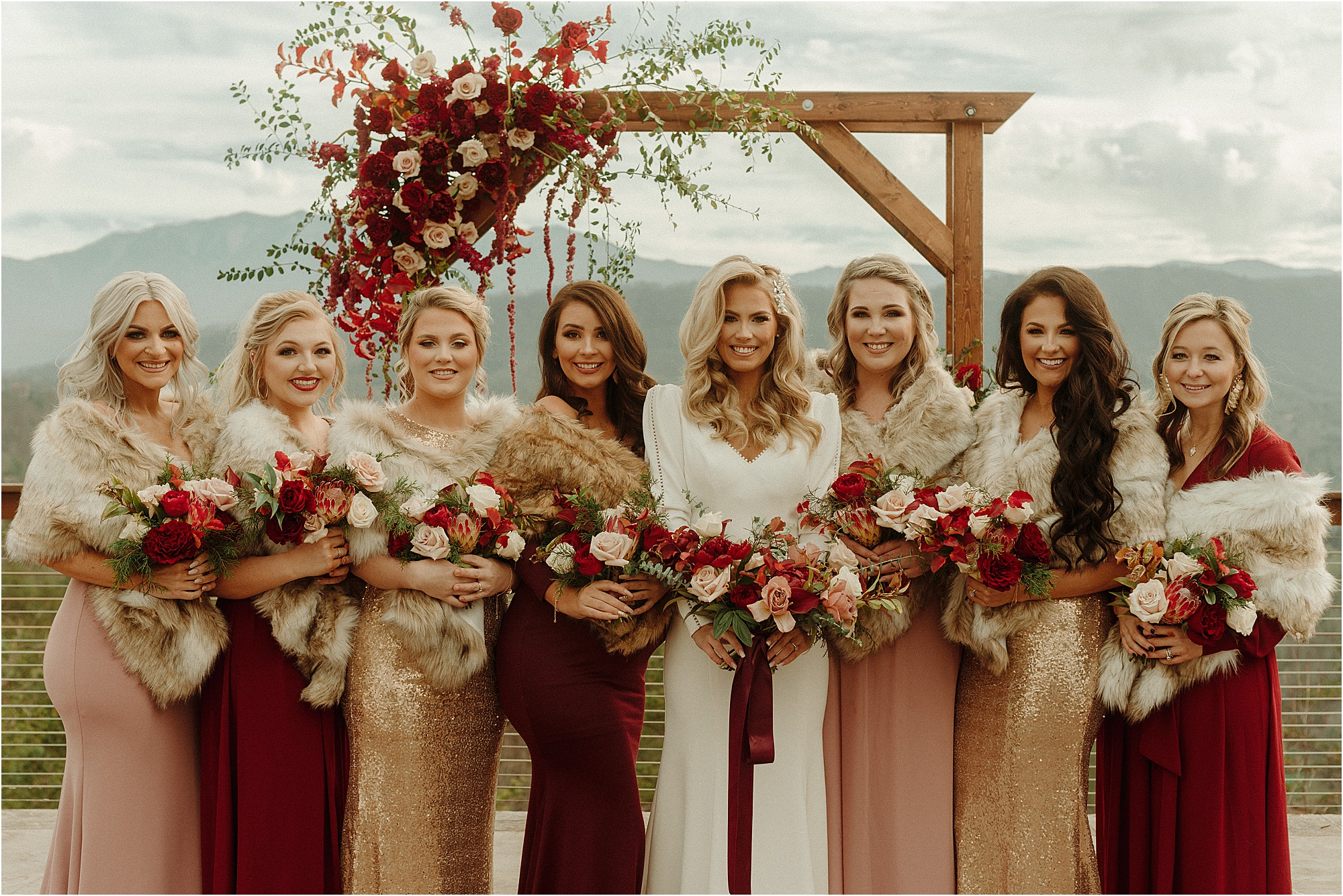 bride and bridesmaids in mismatched moody dresses
