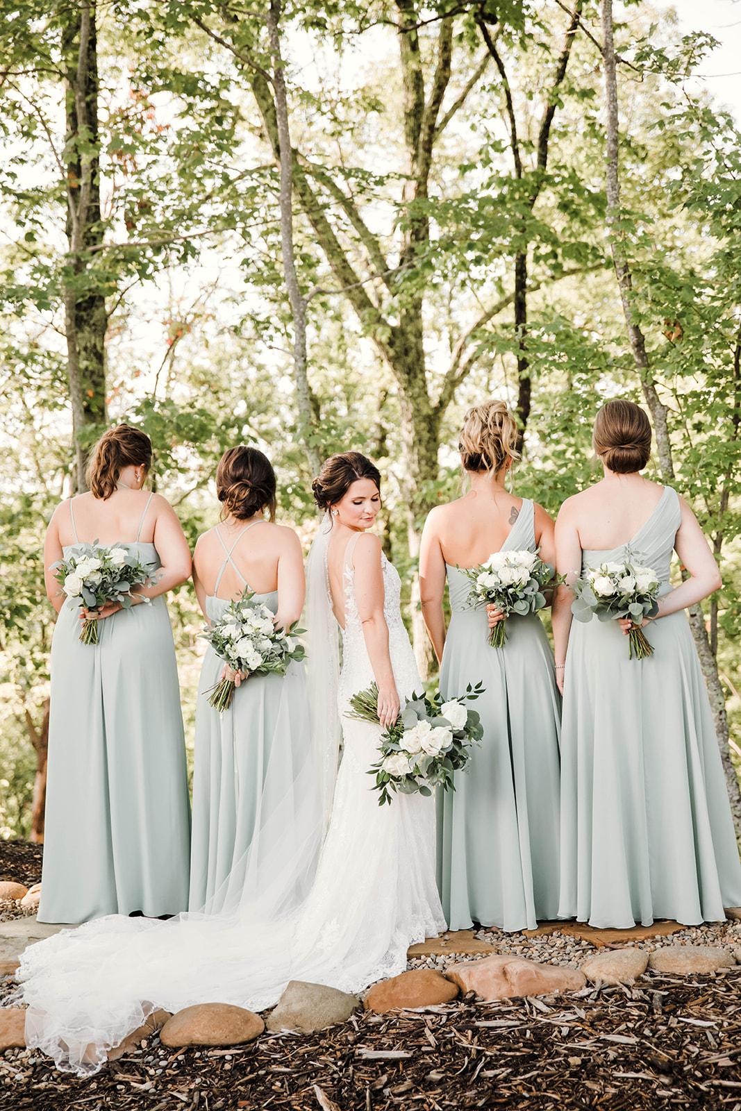 bride looking over her shoulder with bridesmaids