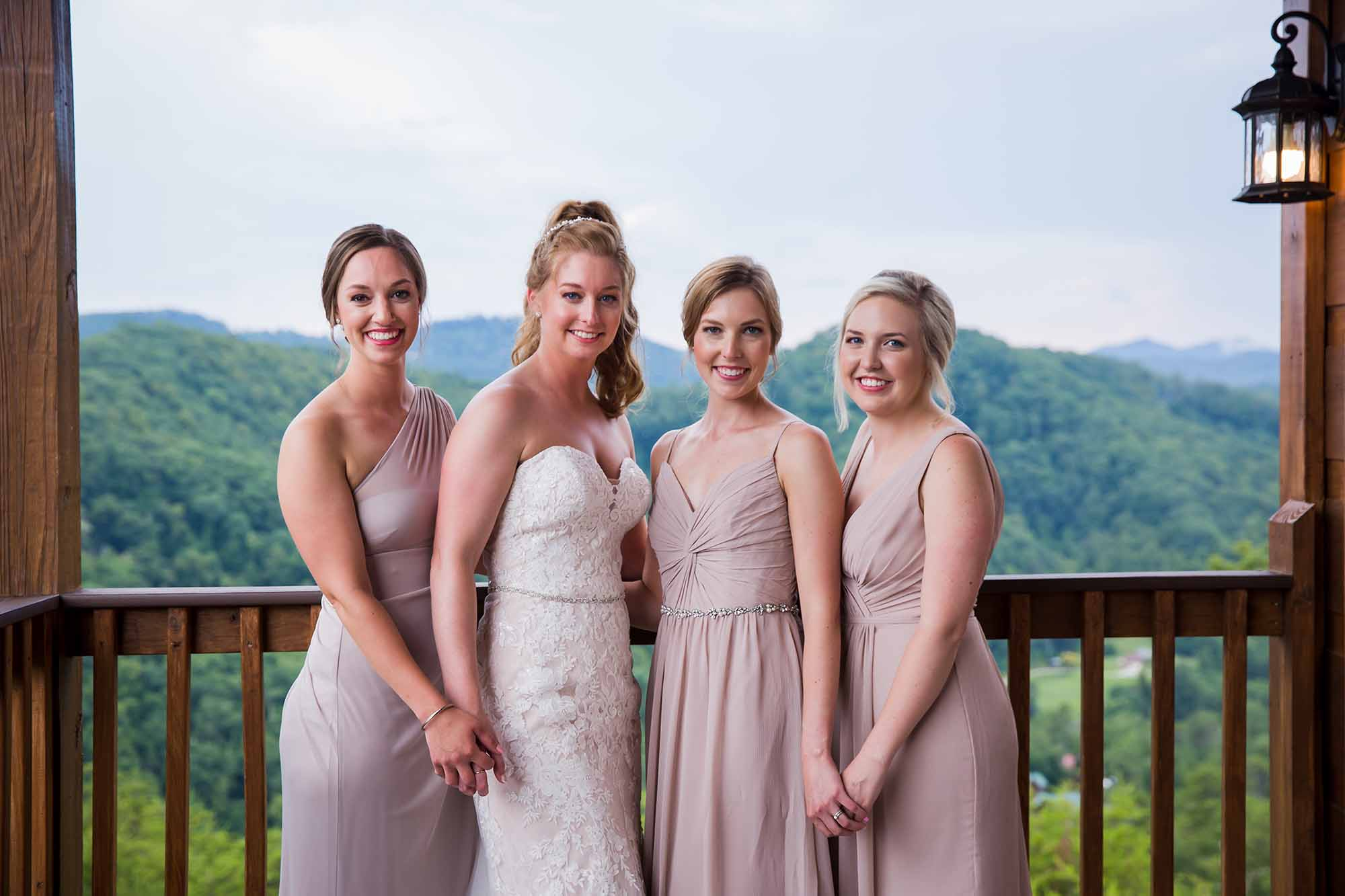 bride and bridesmaids holding hands
