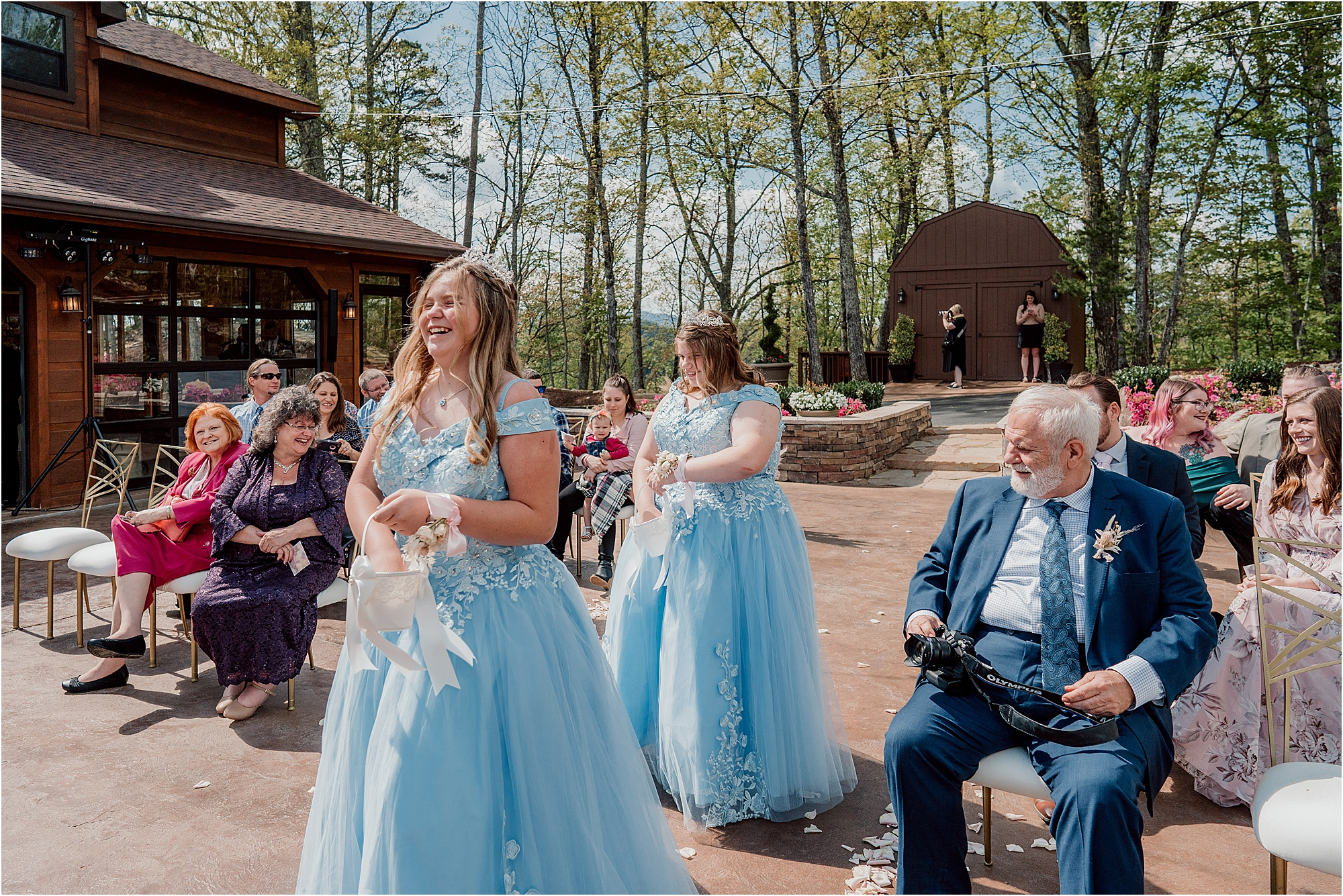 bridesmaids in blue fairytale gowns walking down wedding aisle
