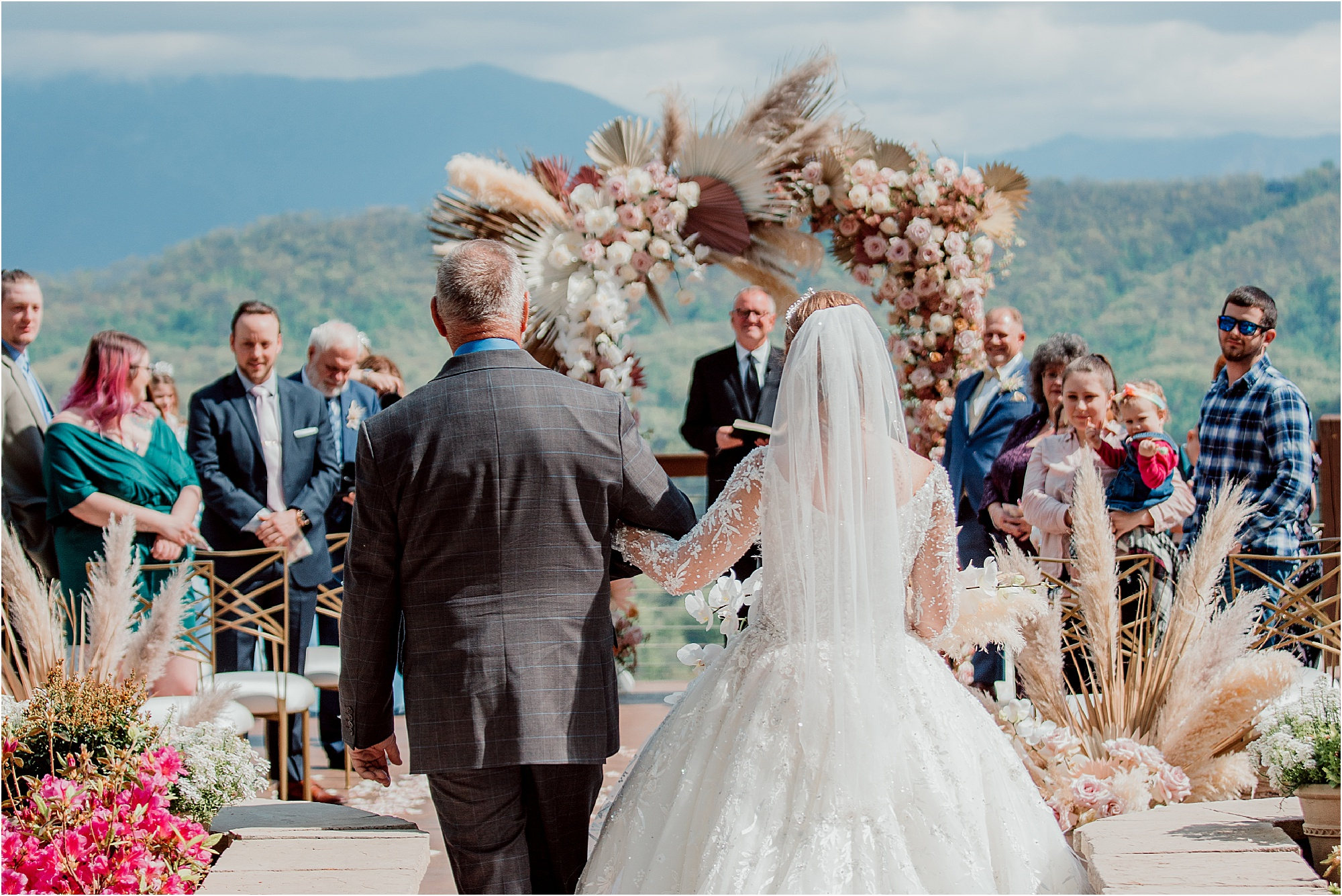 bride walking with father down wedding aisle