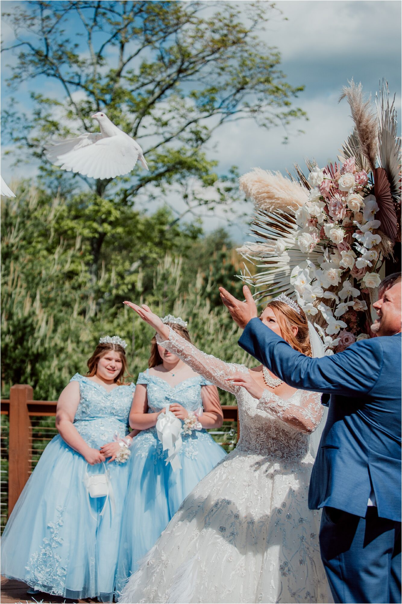 bride and groom release Doves at wedding ceremony