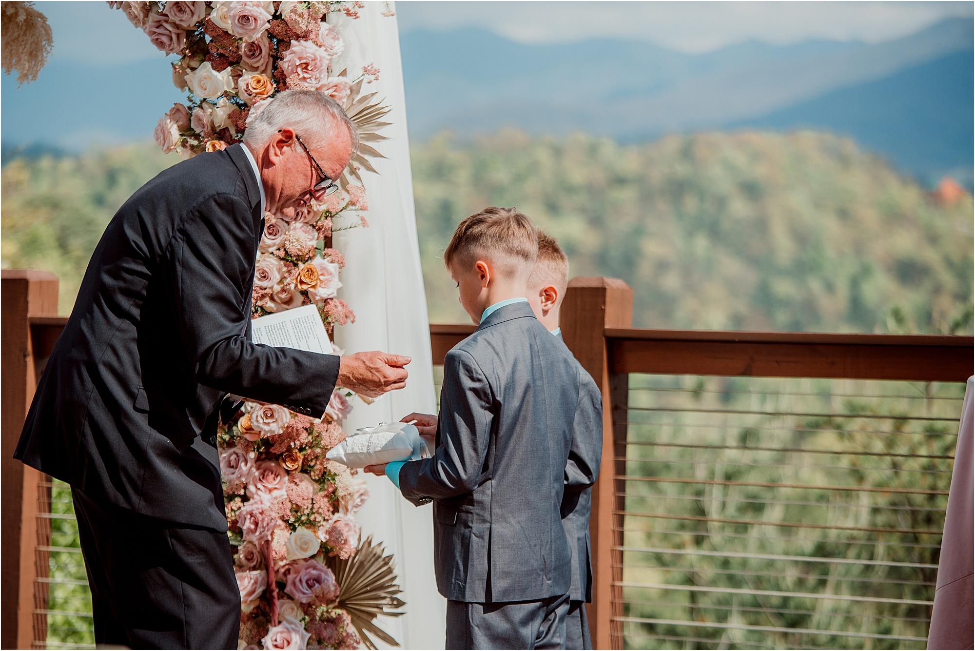 ring bearer handing officiant rings