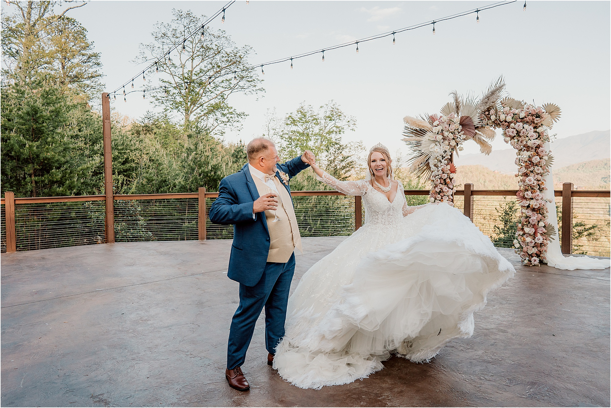 bride and groom dance on patio