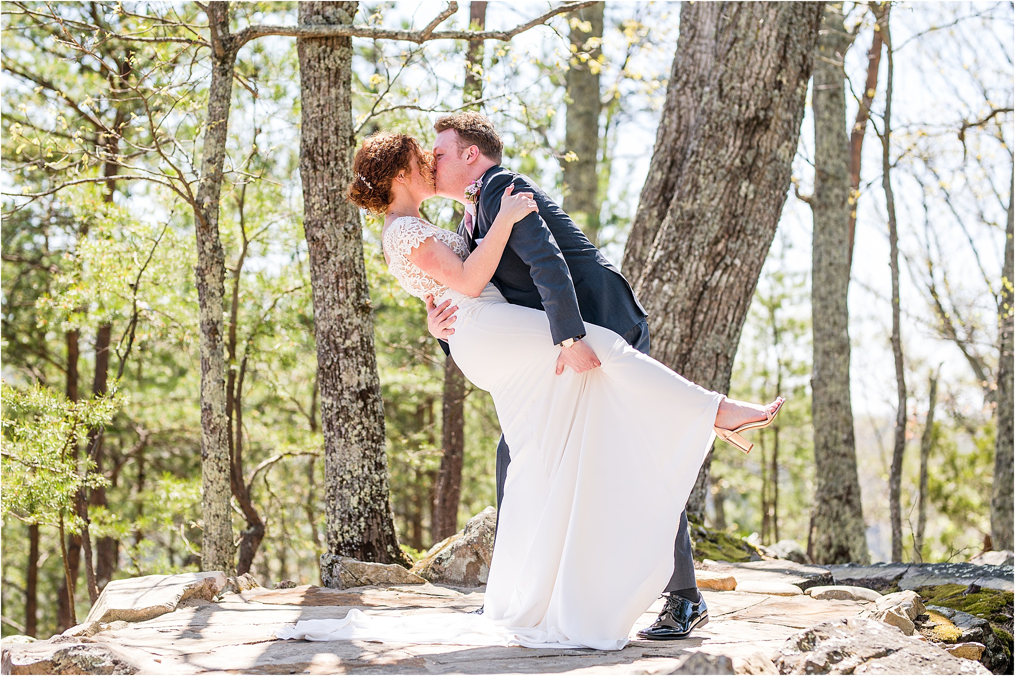 groom dips bride and kisses her