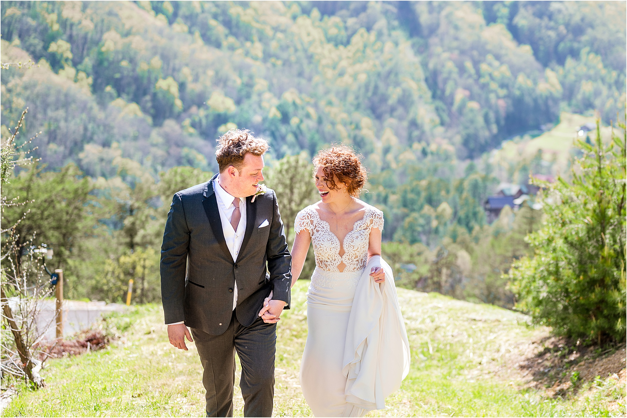 bride and groom walking in the Smoky Mountains