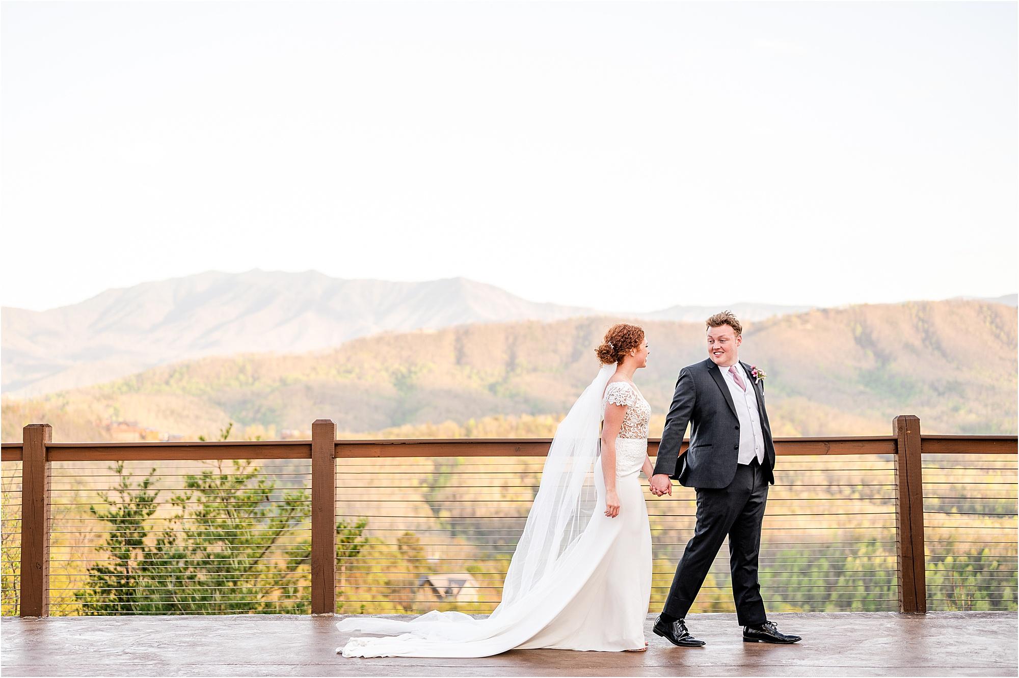 bride and groom walking on patio overlooking the Smokies