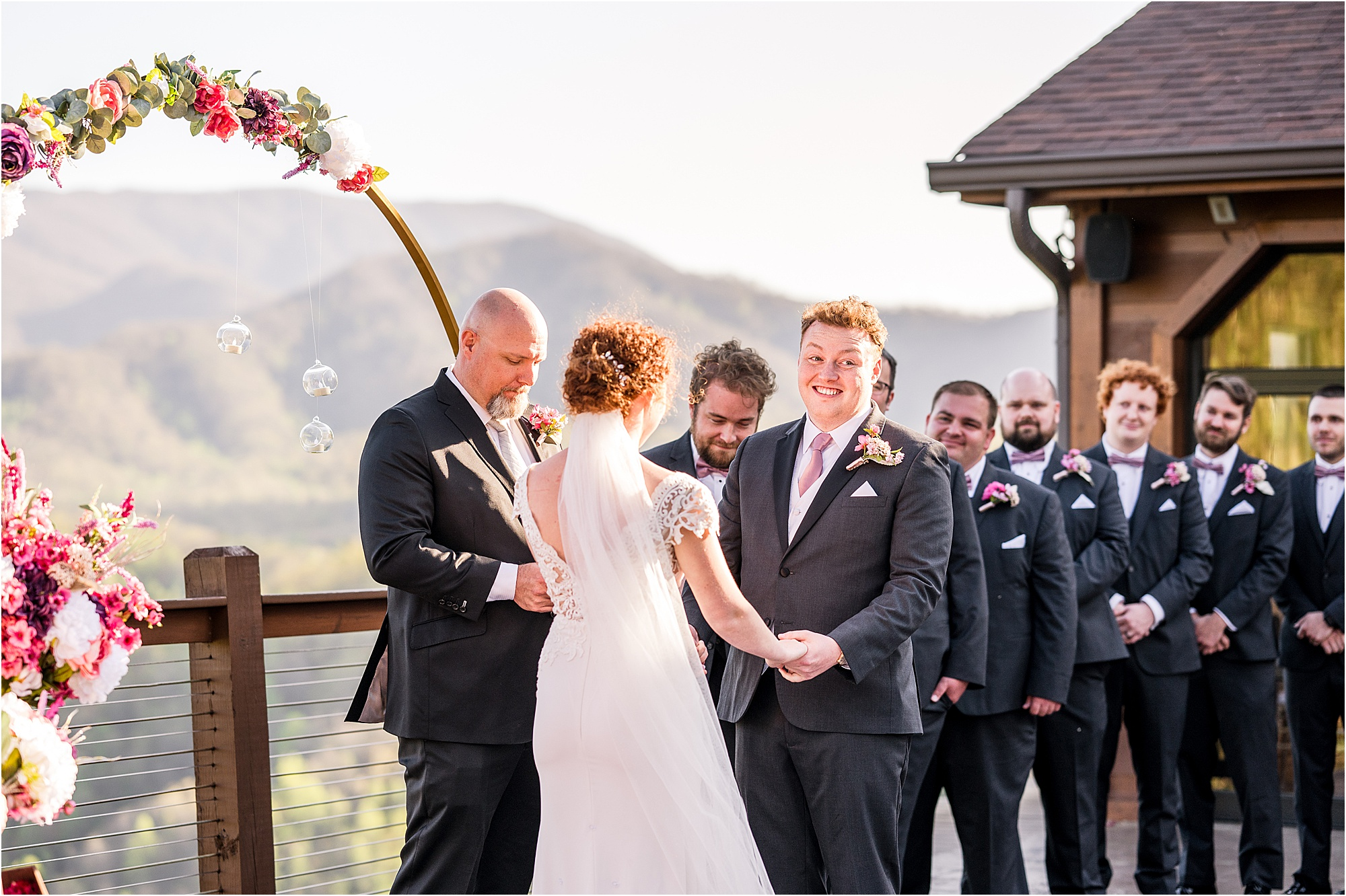 groom laughing at wedding ceremony