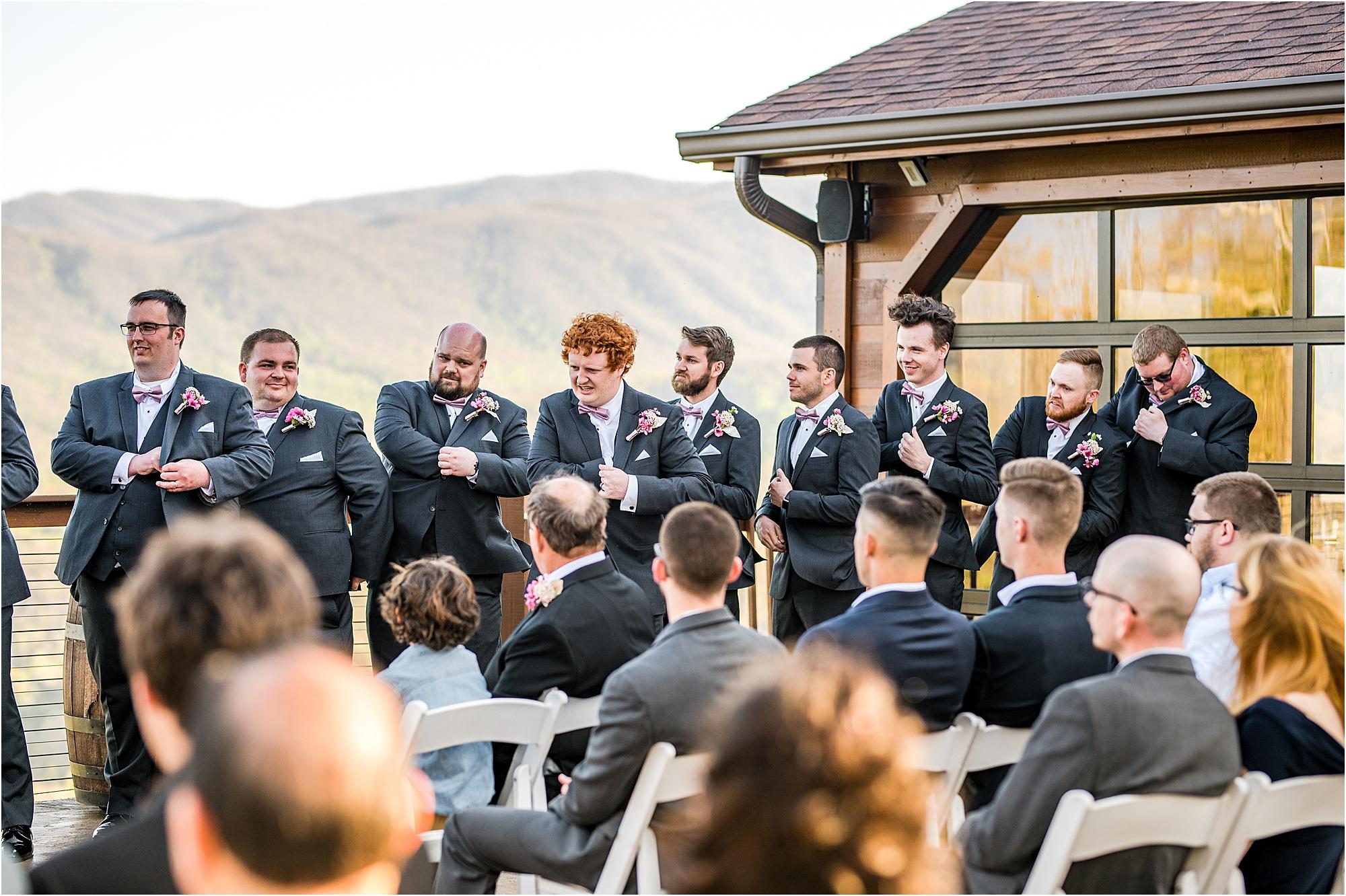 groomsmen trick at wedding ceremony