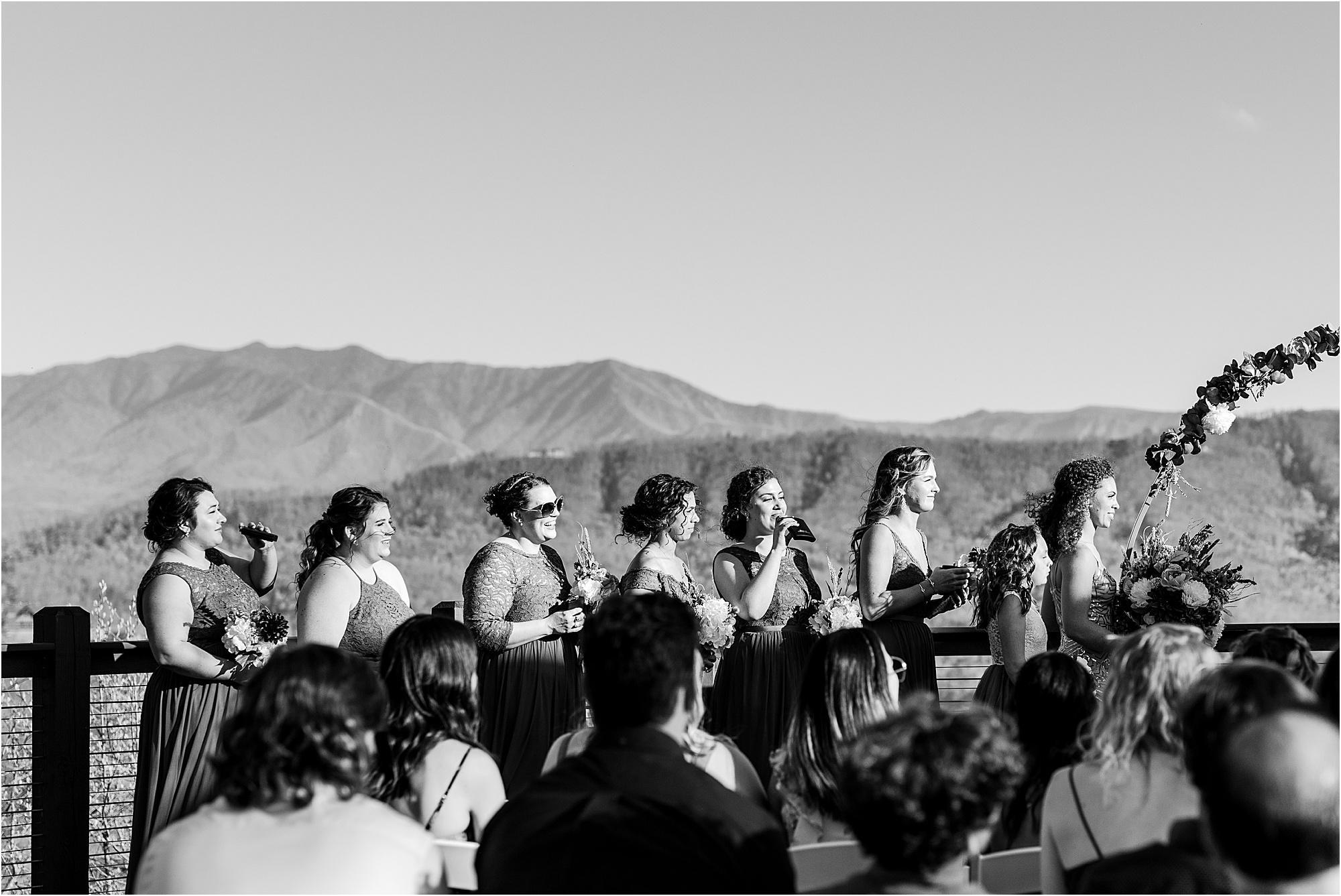 bridesmaids drinking from flasks at wedding ceremony
