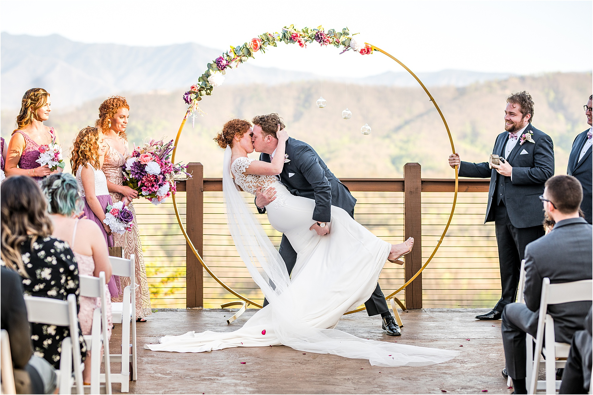 first kiss at wedding ceremony in the mountains