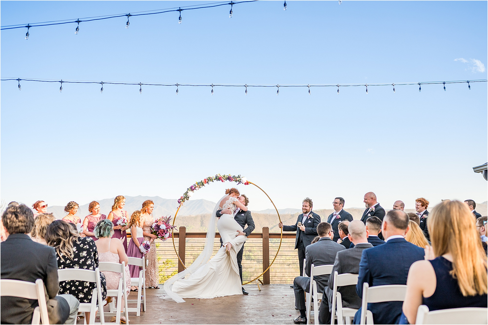 bride umps into grooms arms during first kiss at Eclectic Wedding