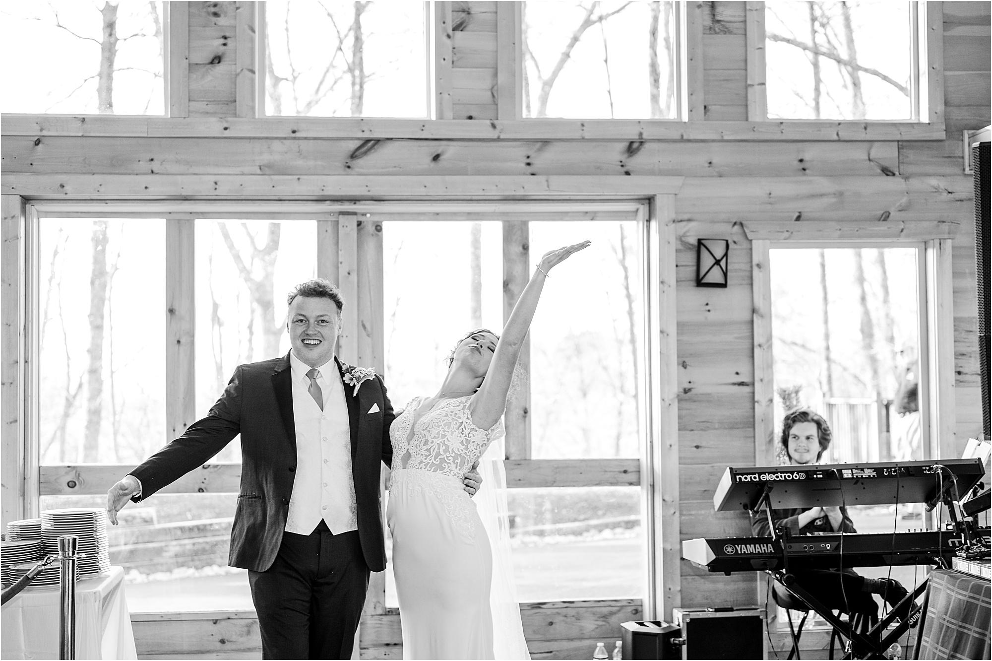 bride and groom enter reception in Grand Hall at The Magnolia Venue