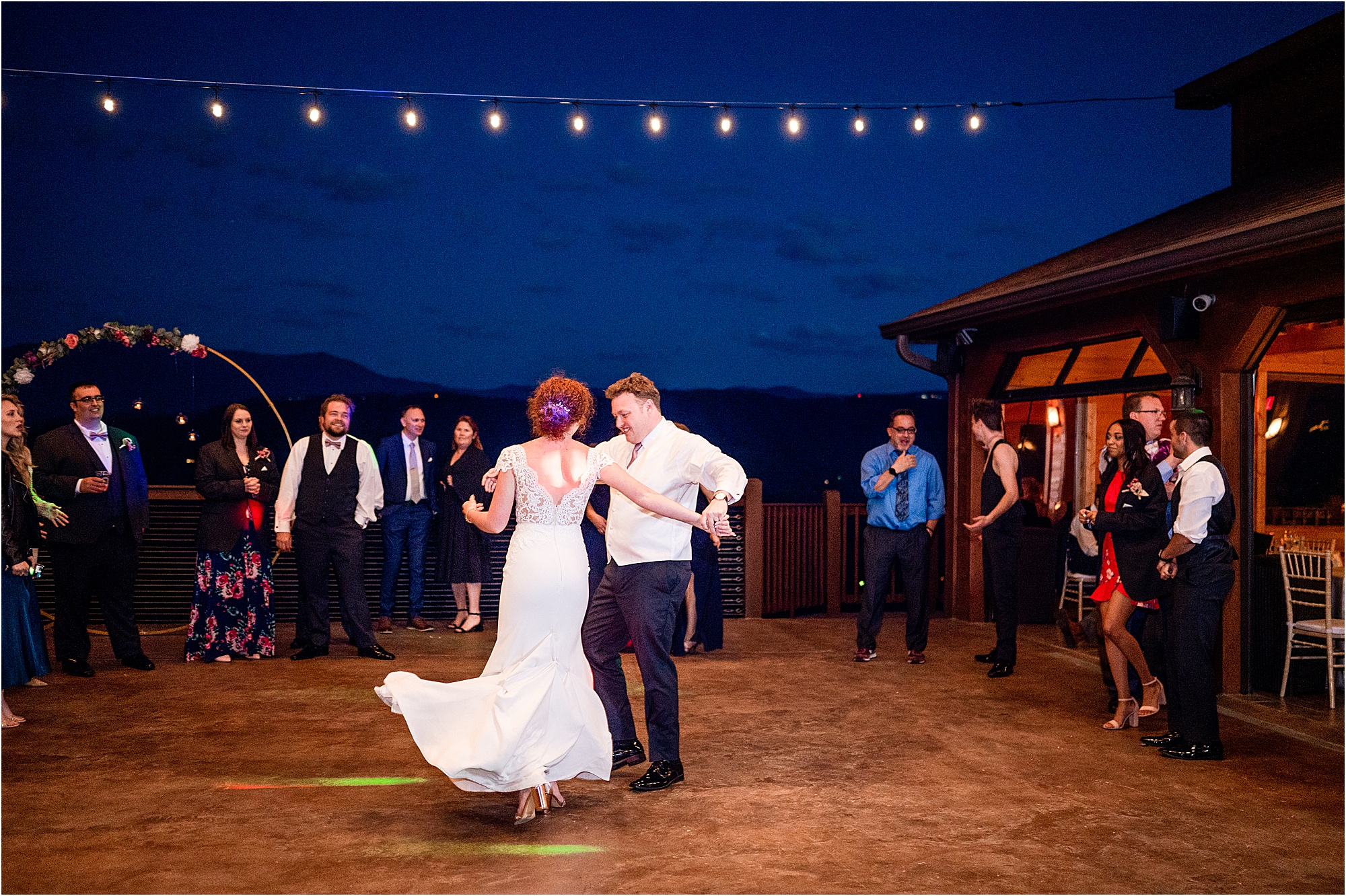 bride and groom first dance on patio overlooking the Smokies