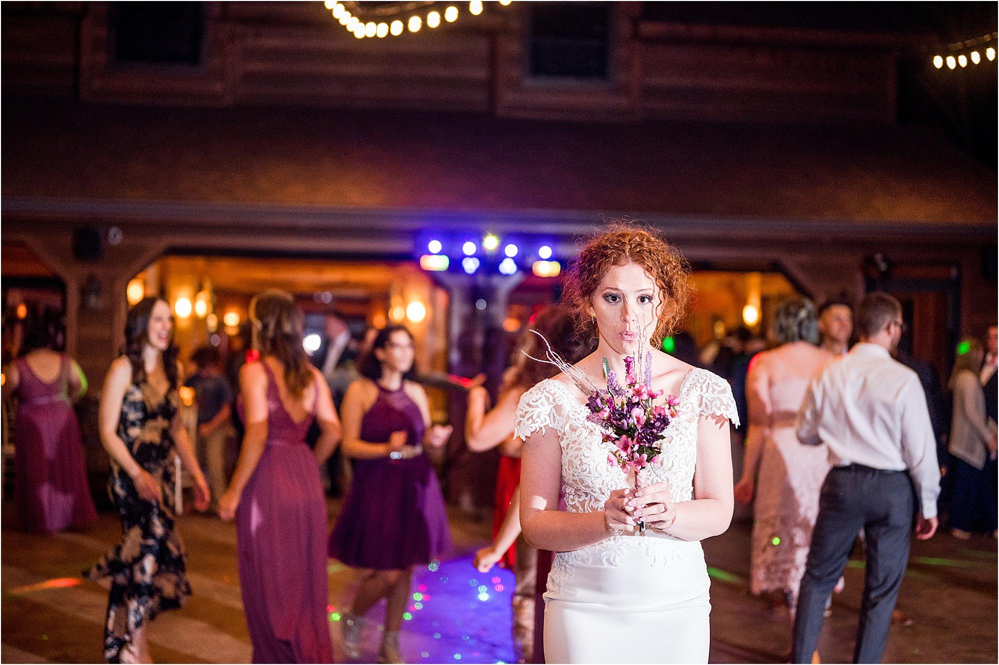 bride tosses bouquet into bridesmaids