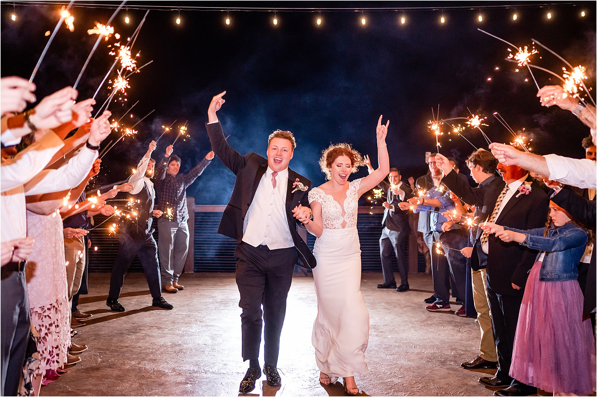 bride and groom exit with sparklers at wedding day