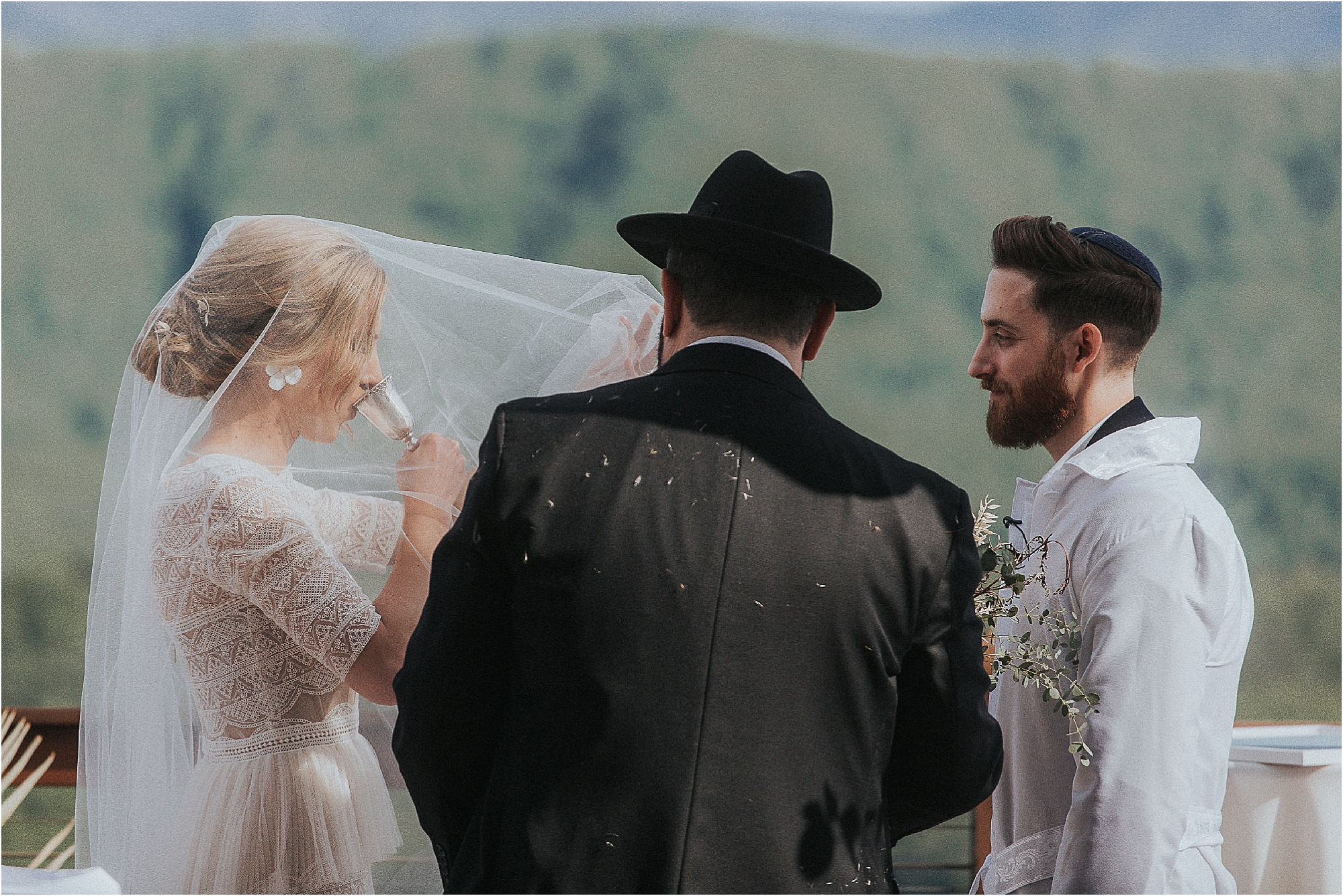 Jewish wedding ceremony and sipping wine