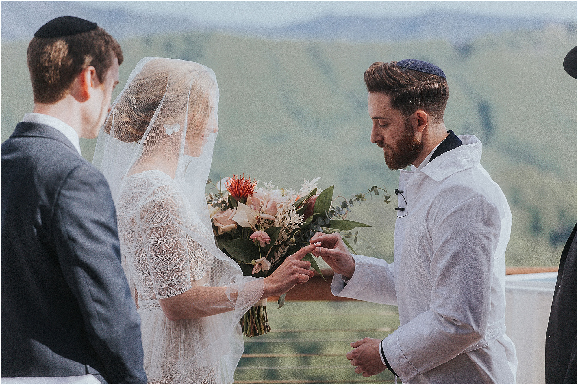 exchanging of rings under Huppah at ceremony