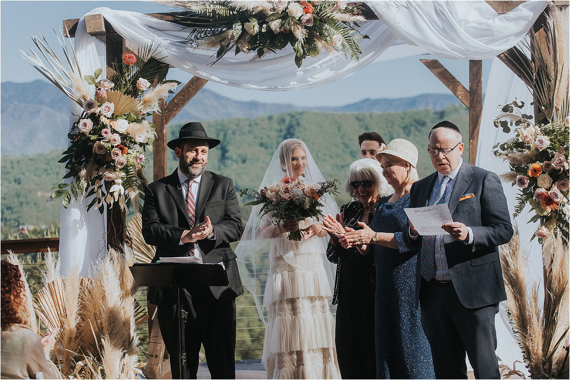 Jewish wedding ceremony under white Huppah