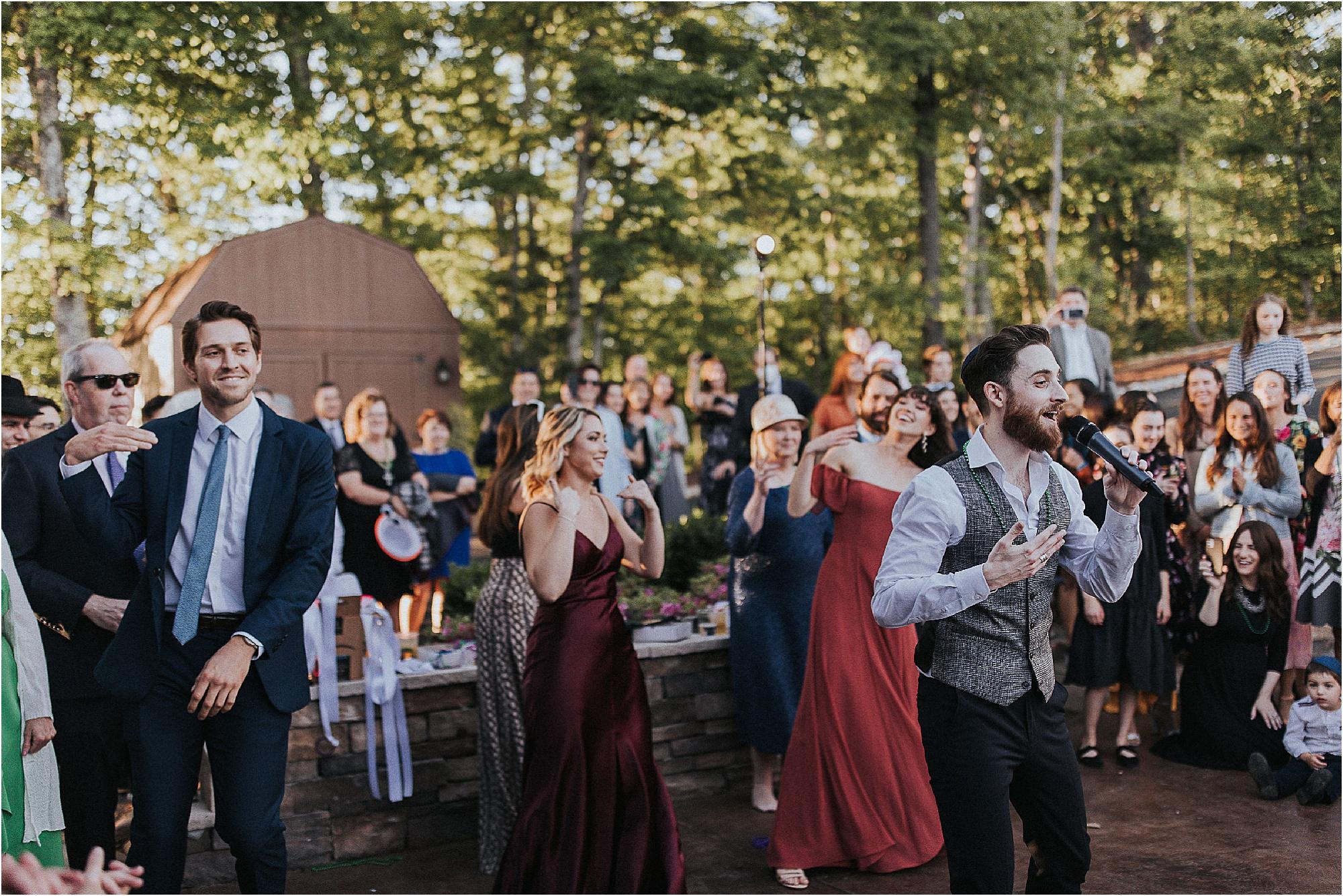 groom signs at wedding reception
